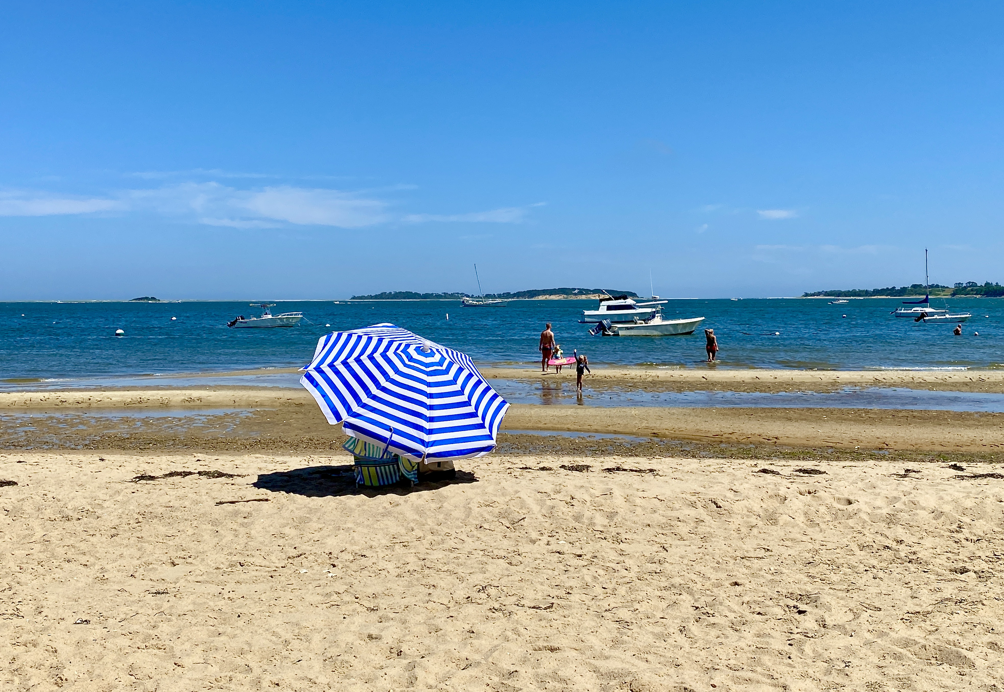 A woman protects herself from the sun at South Orleans Beach on Pleasant Bay in Orleans.