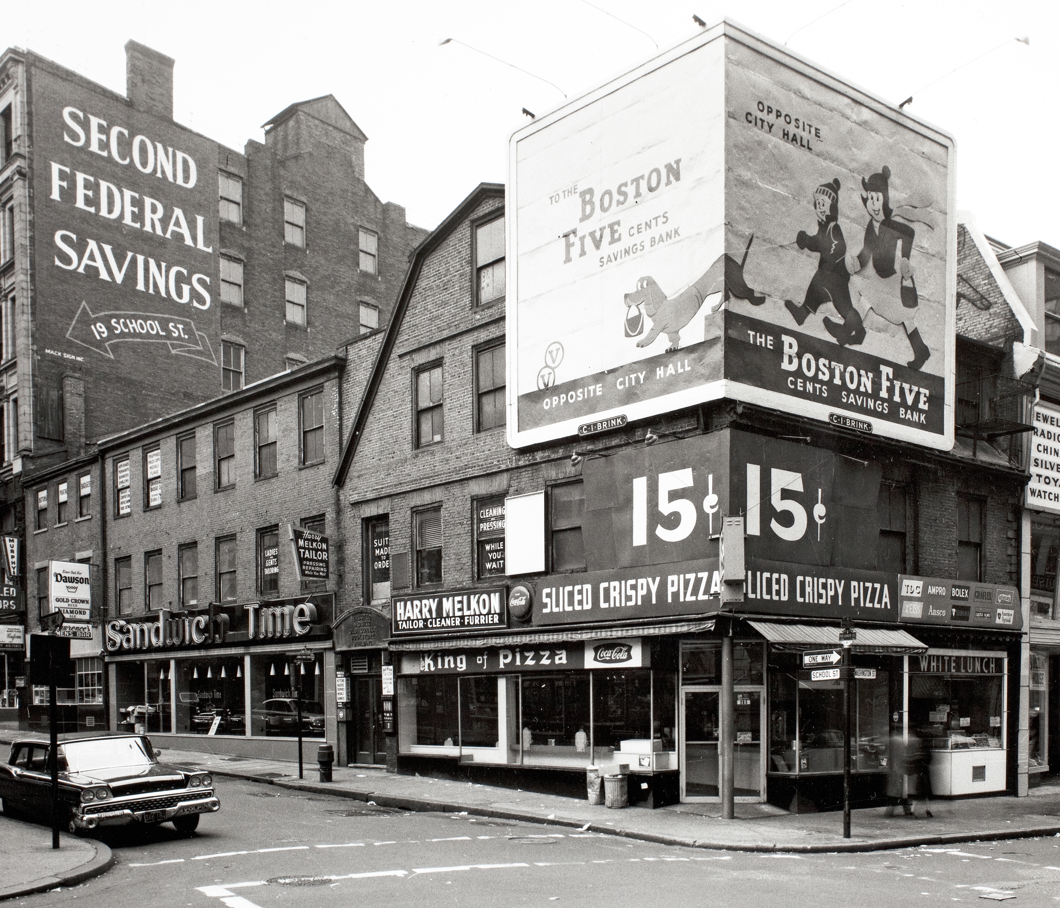 Five decades or so ago an unsightly billboard towered over one of Boston's oldest buildings, the Old Corner Bookstore.