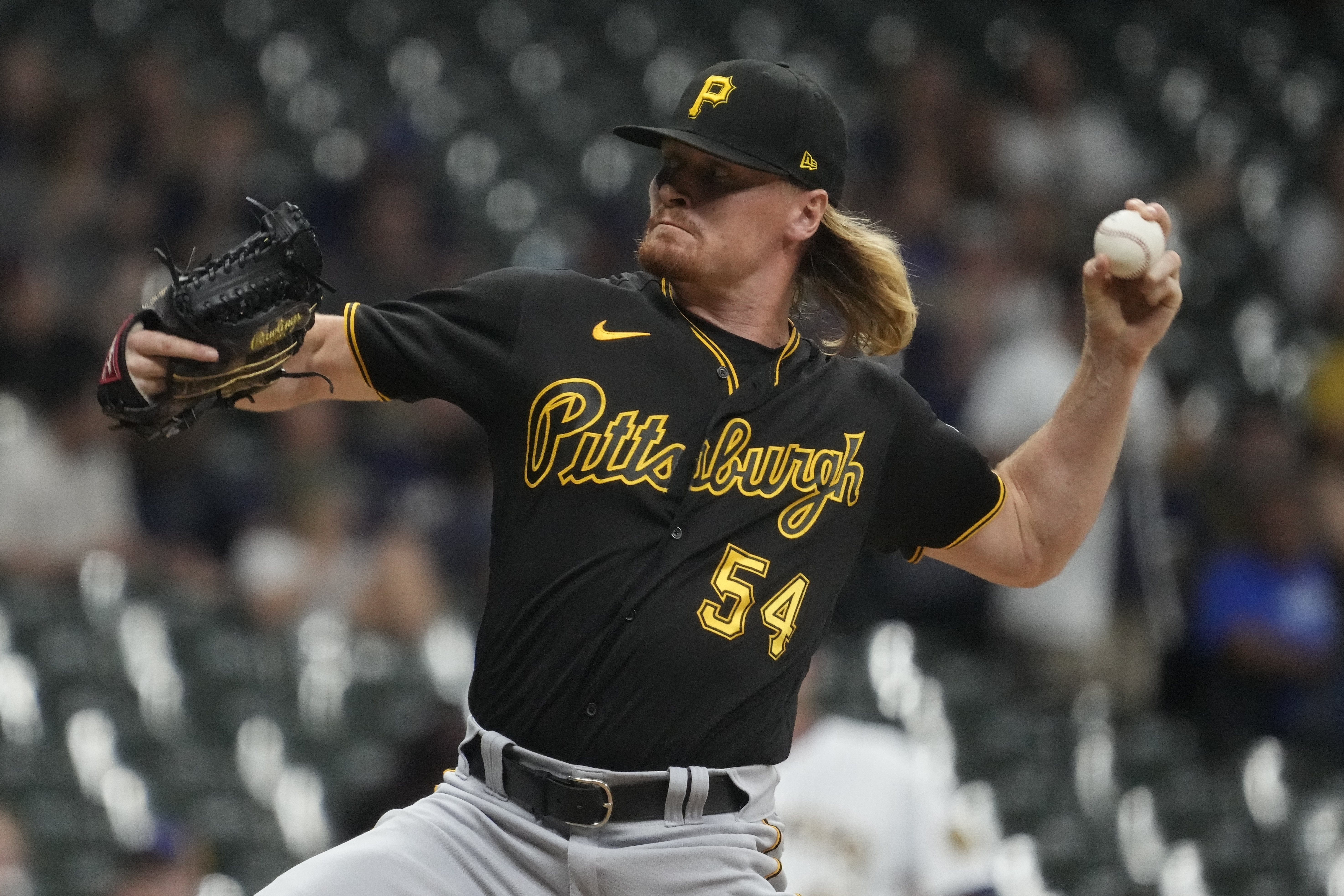 Brewers win 7-4 by capitalizing on Pirates' control problems