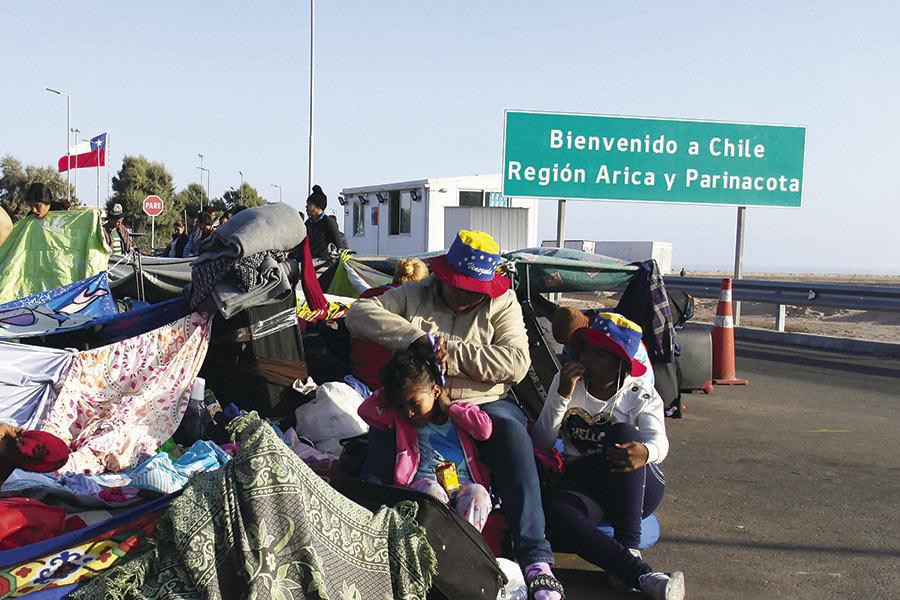 A un año de Chacalluta: población venezolana y derechos vulnerados - La  Tercera