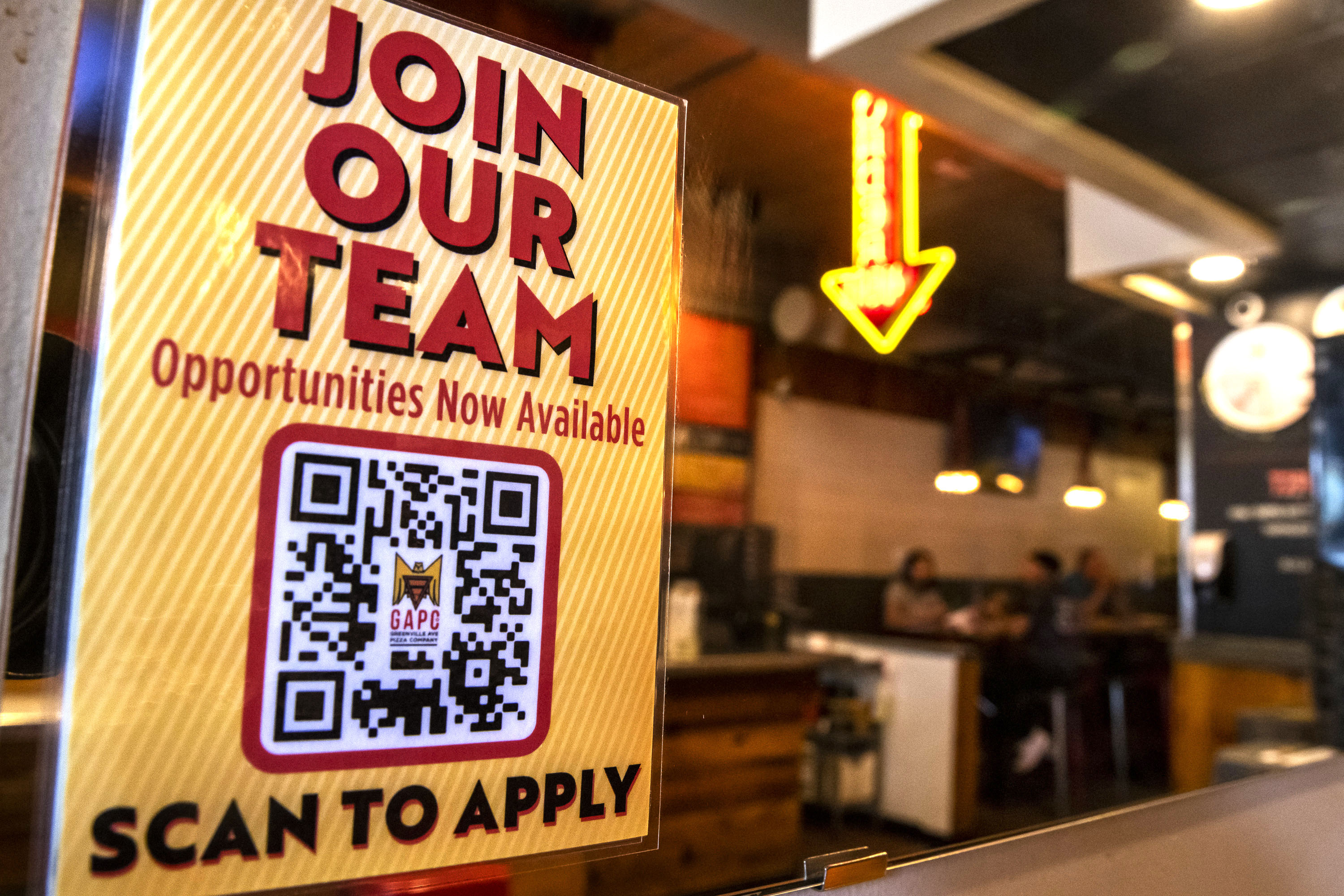 A sign advertises employment opportunities at Greenville Avenue Pizza Company in Dallas on Tuesday, June 8, 2021. Some companies have taken to offering incentives to attract new employees. Greenville Avenue Pizza Company offers $200 to new hires after six weeks of service.