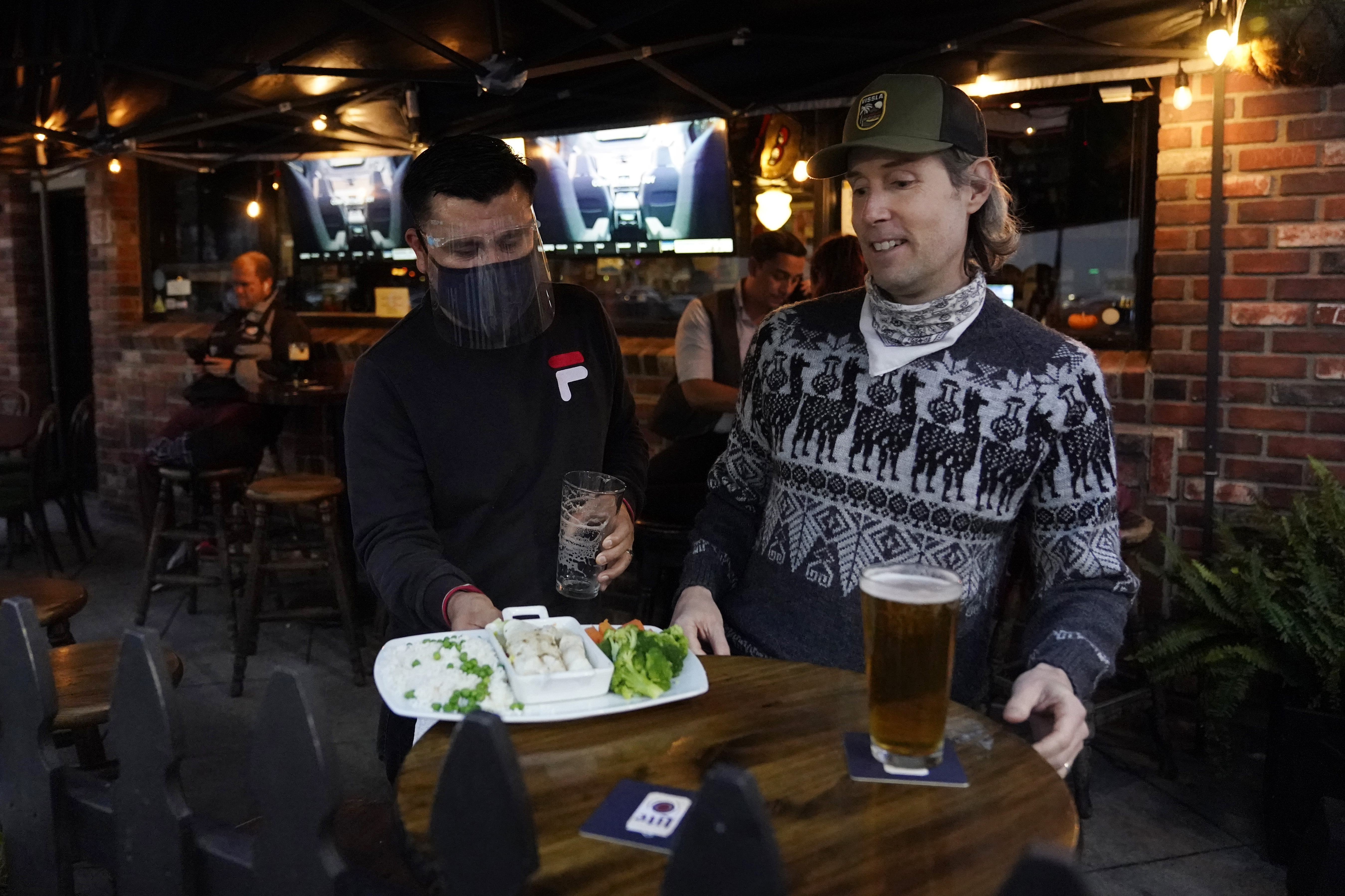 California pub tries to keep calm, carry on with virus rules