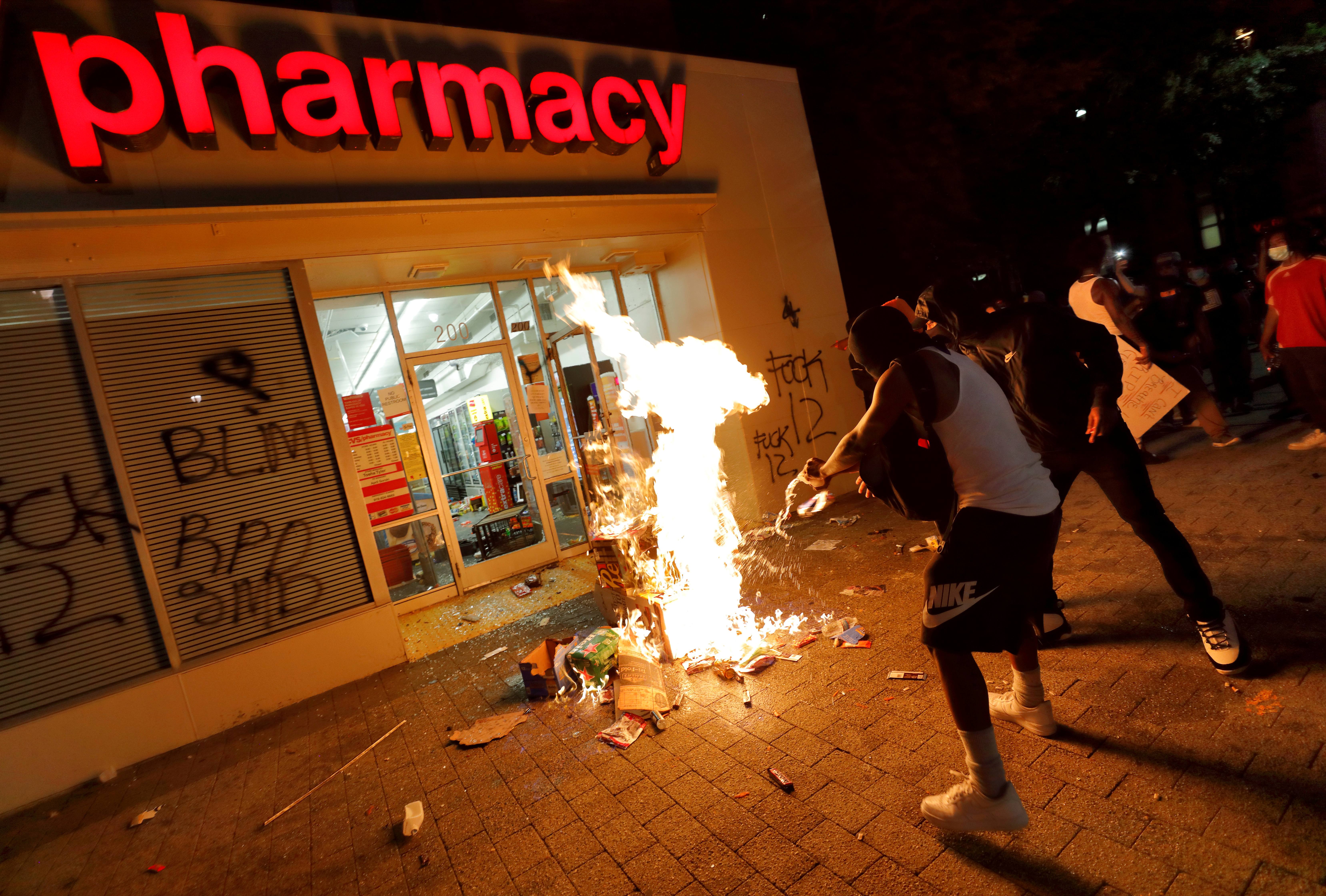 SENSITIVE MATERIAL. THIS IMAGE MAY OFFEND OR DISTURB People set fire to items looted from a CVS Pharmacy during nationwide unrest following the death in Minneapolis police custody of George Floyd, in Raleigh, North Carolina, U.S. May 30, 2020. Picture taken May 30, 2020. REUTERS/Jonathan Drake TPX IMAGES OF THE DAY