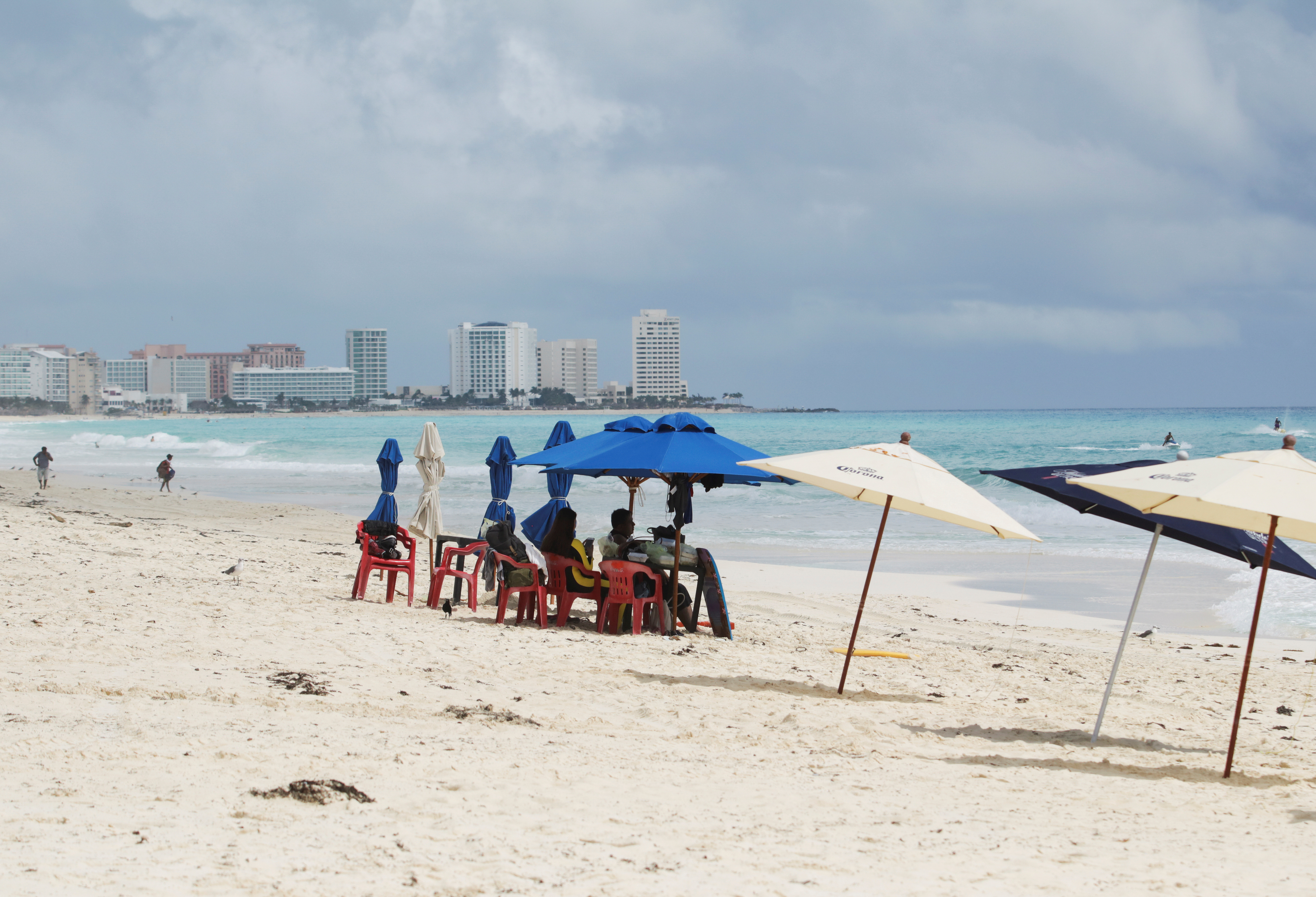 FILE PHOTO: Tourists are seen at a beach in Cancun, Mexico October 6, 2020. REUTERS/Jorge Delgado/File Photo
