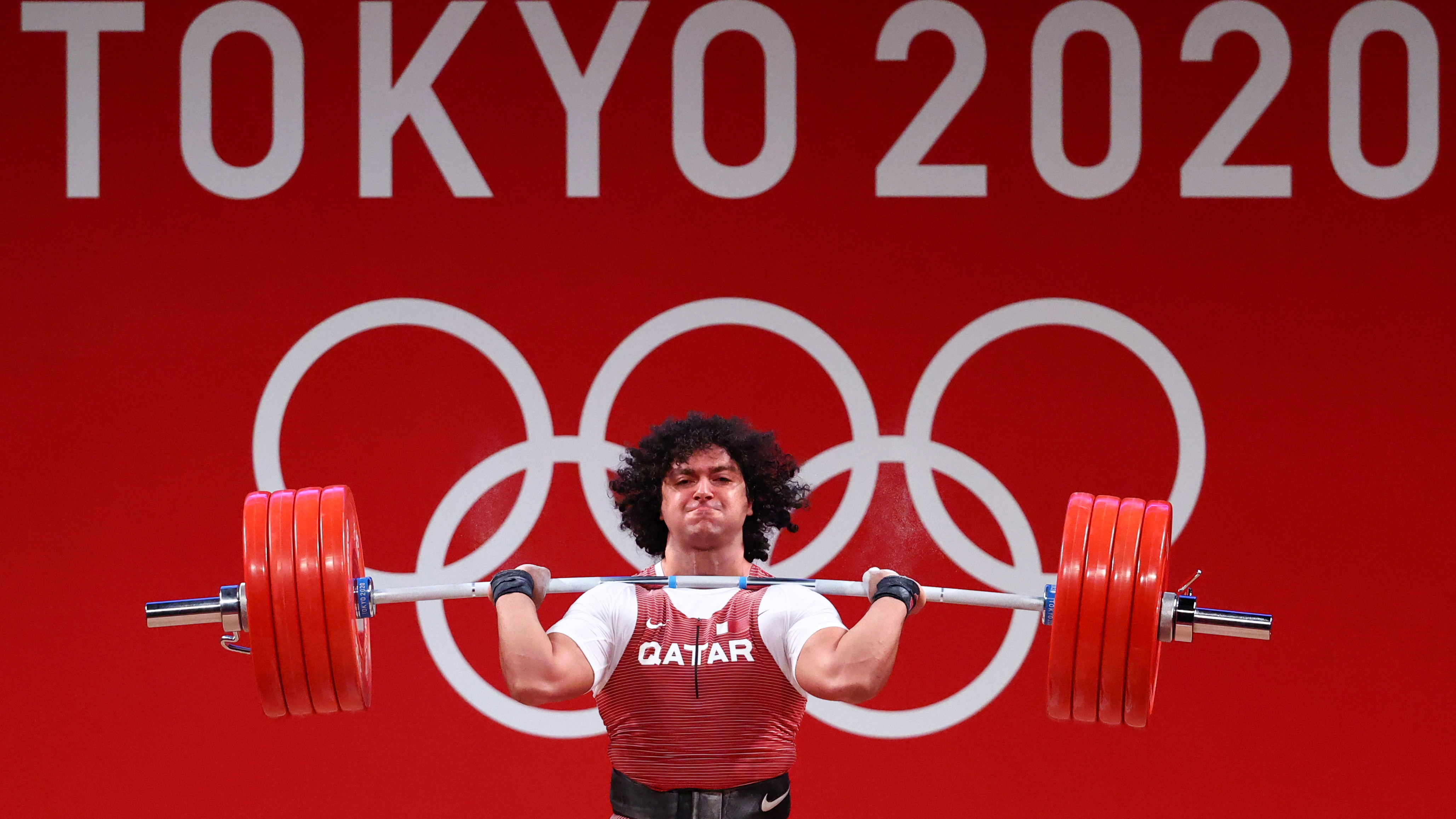 Weightlifter El-Bakh becomes Qatar's first Olympic champion, setting  records in the process - Infobae