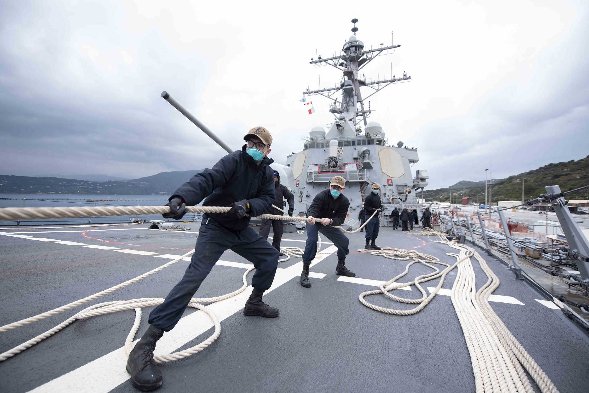 Sailors heave in line as the Arleigh Burke-class guided-missile destroyer USS Mitscher (DDG 57) prepares to depart Souda Bay, Greece, March 24, 2021. (MC2 Kaleb J. Sarten/Navy)