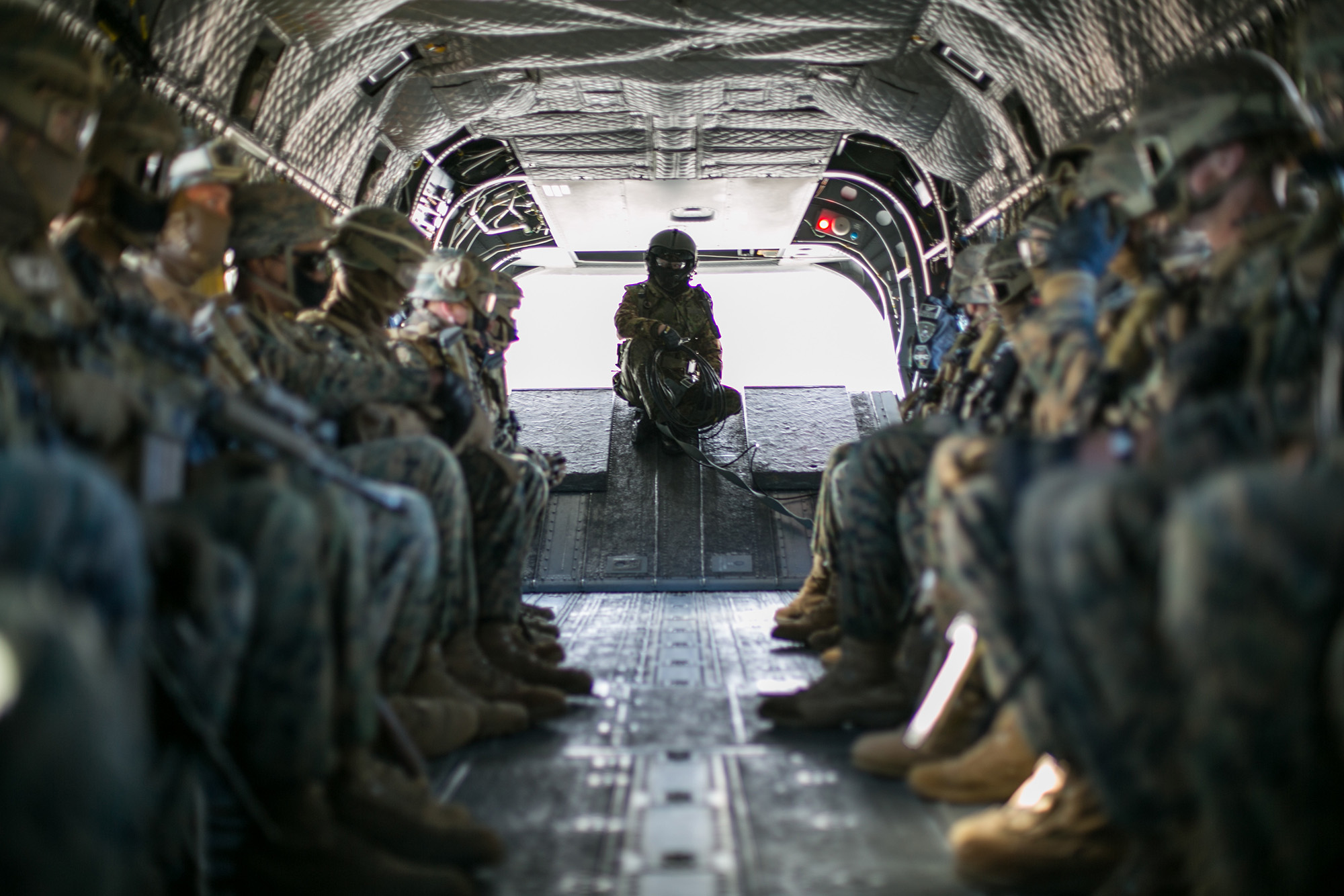A crew chief with the 30th Infantry Regiment, 12th Brigade, Japan Ground Self-Defense Force and U.S. Marines conduct an air assault during exercise Forest Light Eastern Army in mainland Japan, on Dec. 15, 2020. (Cpl. Levi J. Guerra/Marine Corps)