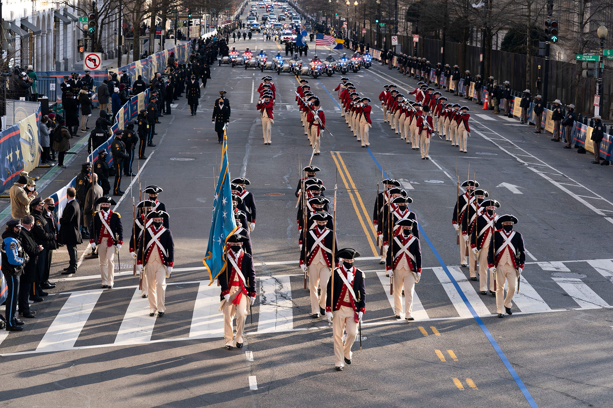 Members of the military march on 15th Street towards the White House during a presidential escort to the White House following President Joe Biden taking the oath of office in Washington on Jan. 20, 2021. (Jose Luis Magana/Pool, AFP via Getty Images)