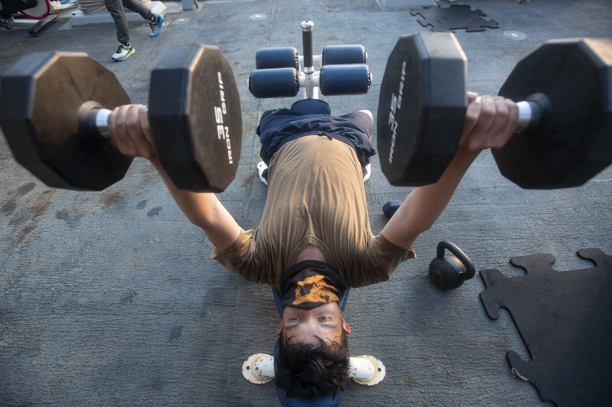 Boatswain's Mate Seaman Apprentice Esau Arellano, assigned to the Arleigh Burke-class guided-missile destroyer USS Ralph Johnson (DDG 114), engages in physical fitness while underway on Aug. 4, 2020, in the Arabian Gulf. (MC3 Anthony Collier/Navy)