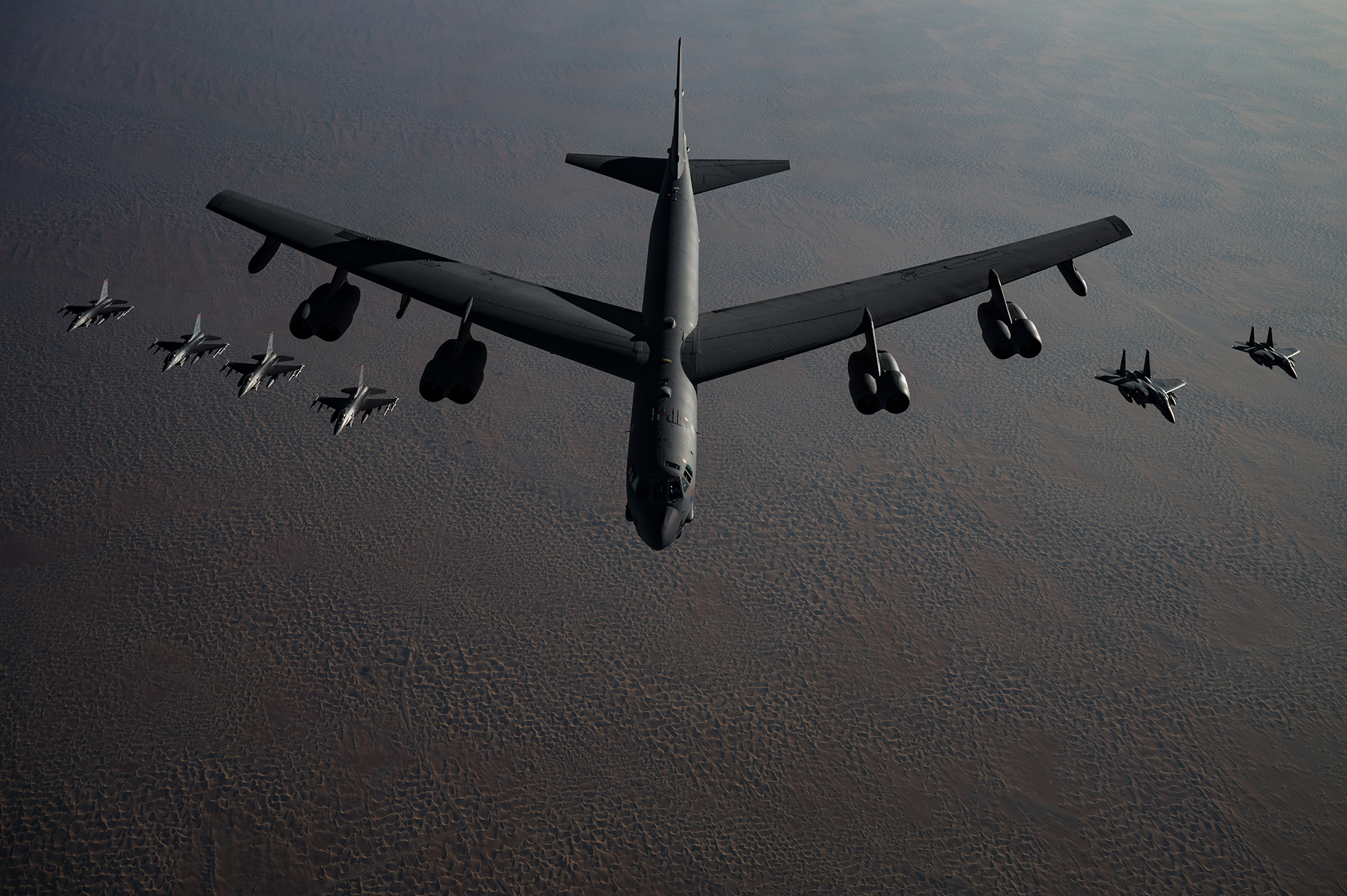 A B-52 Stratofortress flies in formation with F-16 Fighting Falcons and F-15E Strike Eagles during a Bomber Task Force mission over the U.S. Central Command area of responsibility, Nov. 21, 2020. (Staff Sgt. Sean Carnes/Air Force)