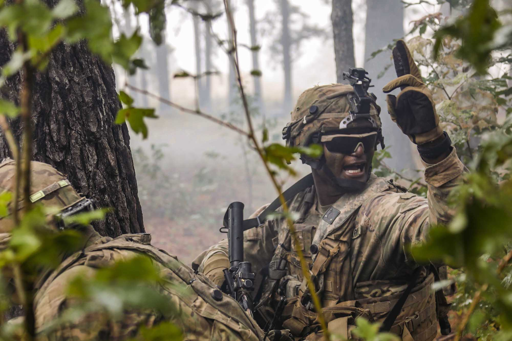 A combat engineer motions his team toward the breach point during the final live-fire exercise of rotation 21-01 on Oct. 27, 2020, at the Joint Readiness Training Center at Fort Polk, La. (Sgt. Thomas Calvert/Army)