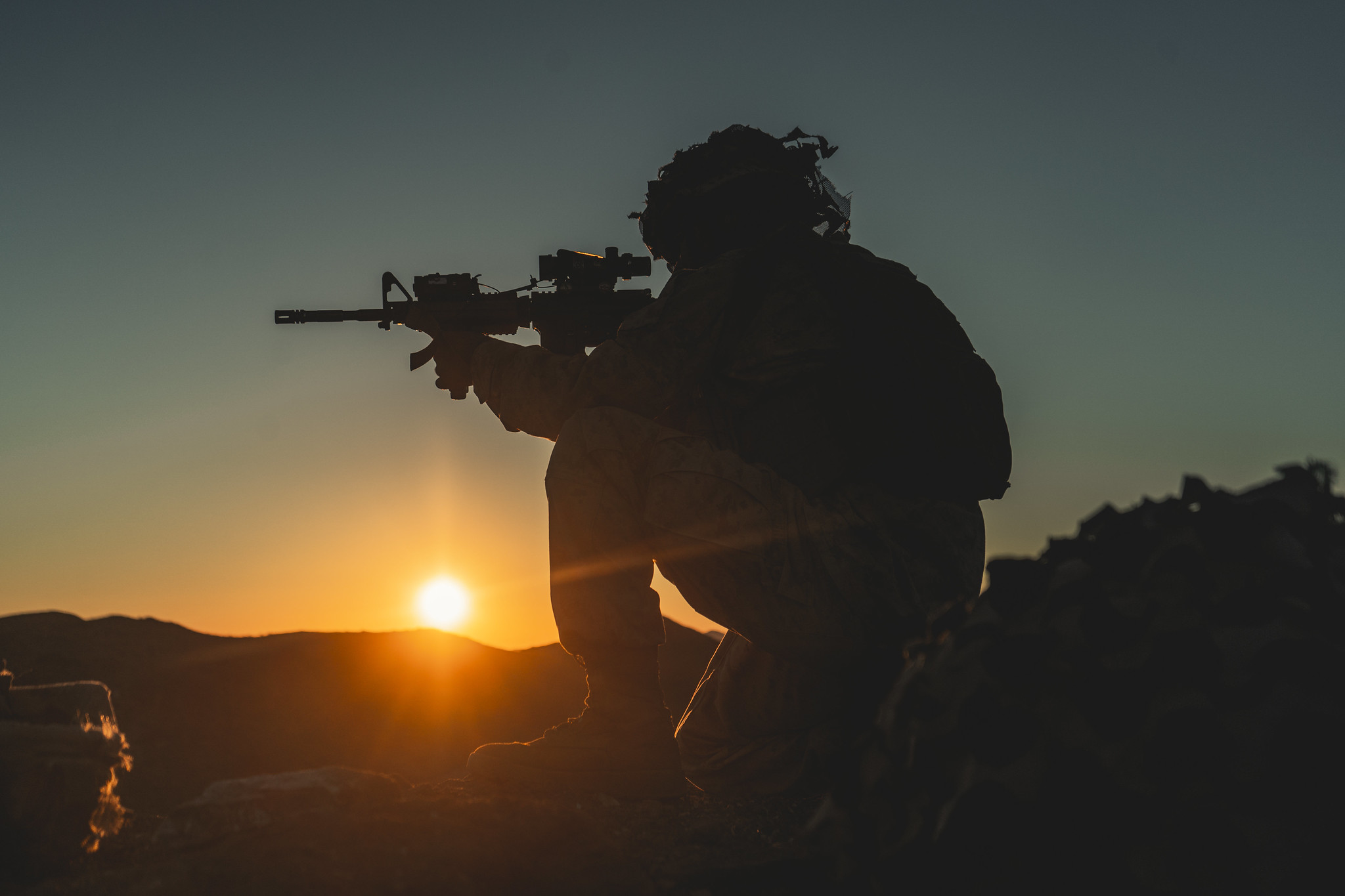 Hospitalman Keifer Ralph sets into a defensive position in support of the Battalion Distributed Operations Course during Service Level Training Exercise 1-21 at Marine Corps Air Ground Combat Center Twentynine Palms, Calif., Oct. 28, 2020. (Lance Cpl. Juan Carpanzano/Marine Corps)