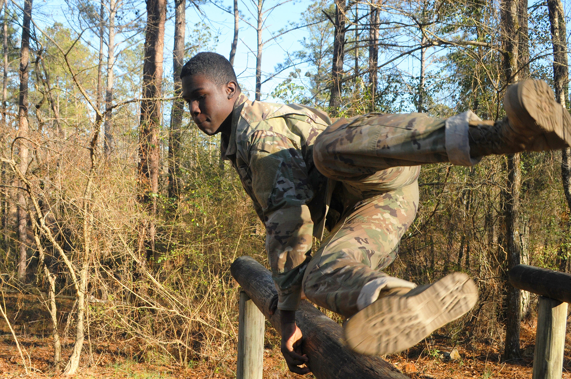 Pfc. Delcoy D. Delius powers through an obstacle course Jan. 23, 2021, as part of the 642nd Regional Support Group Best Warrior Competition at Fort McClellan, Ala. (Sgt. 1st Class Gary A. Witte/Army)