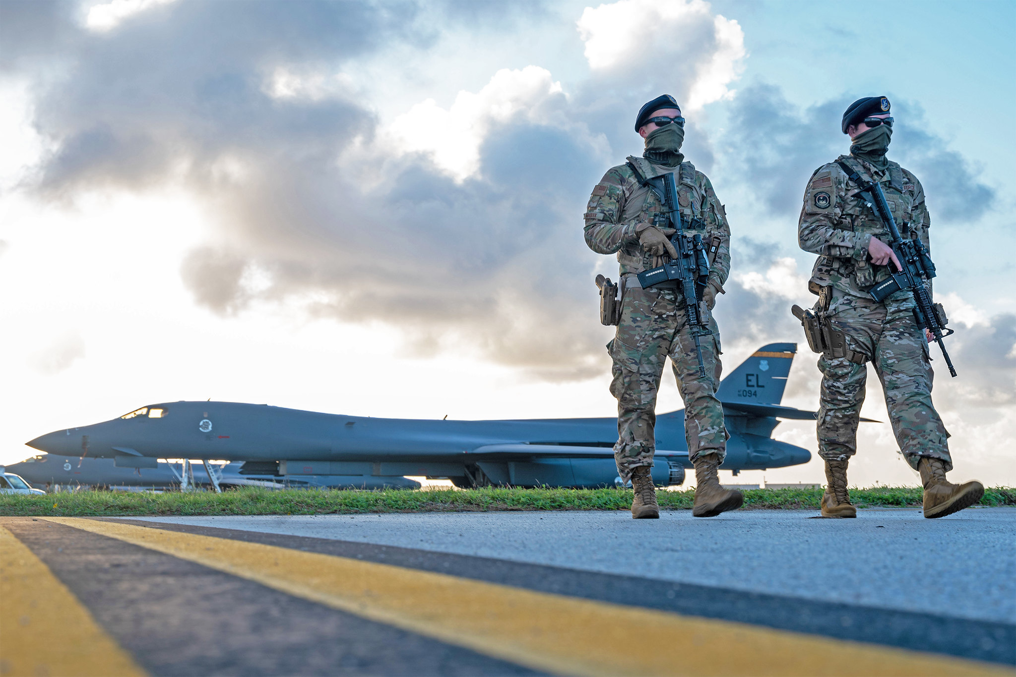 Security forces airmen patrol near a U.S. Air Force B-1B Lancer taxiway at Andersen Air Force Base, Guam, in support of a Bomber Task Force mission, Dec. 26, 2020. (Senior Airman Tristan Day/Air Force)