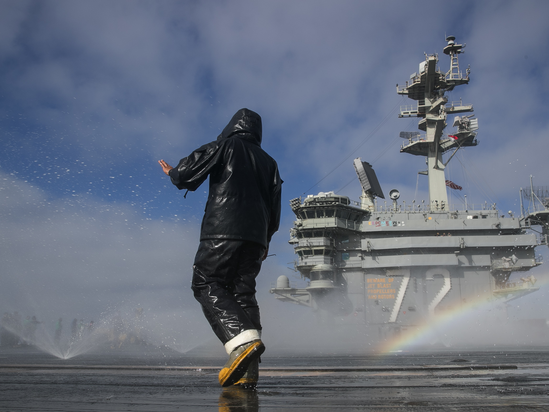 Aviation Boatswain's Mate (Handling) Airman Michael Meneses inspects the flight deck's countermeasure wash-down sprinklers on the aircraft carrier USS Abraham Lincoln (CVN 72) on May 16, 2020, in the Pacific Ocean. (Mass Communication Specialist Seaman Apprentice Javier Reyes/Navy)