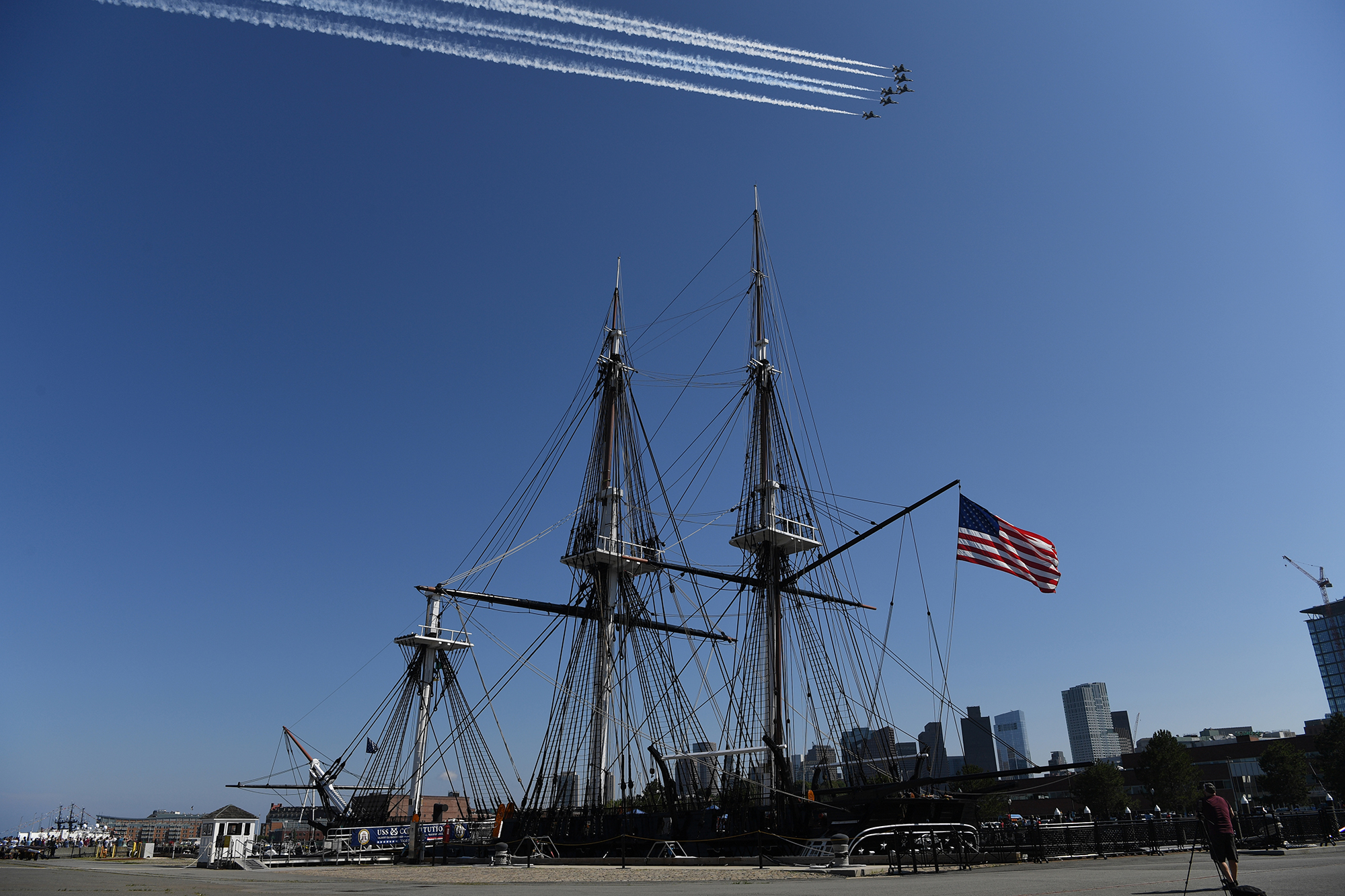 The U.S. Air Force Thunderbirds fly over the USS Constitution in Boston Harbor during a