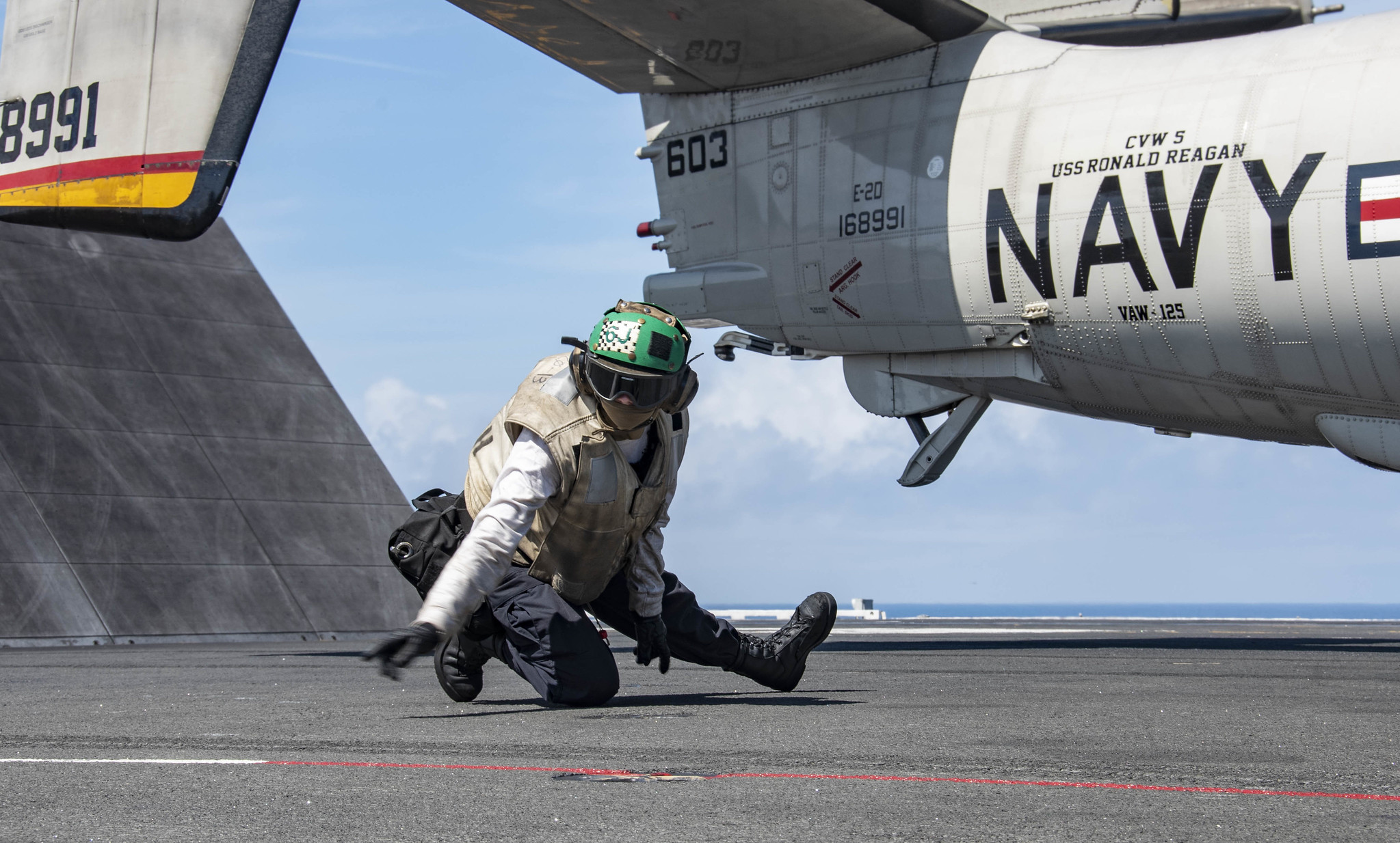 Aviation Machinist's Mate 3rd Class Brandee Robinson conducts final checks on an E-2D Hawkeye as it prepares to launch from the flight deck of the aircraft carrier USS Ronald Reagan (CVN 76) on Aug. 2, 2020, in the Pacific Ocean. (MC3 Erica Bechard/Navy)