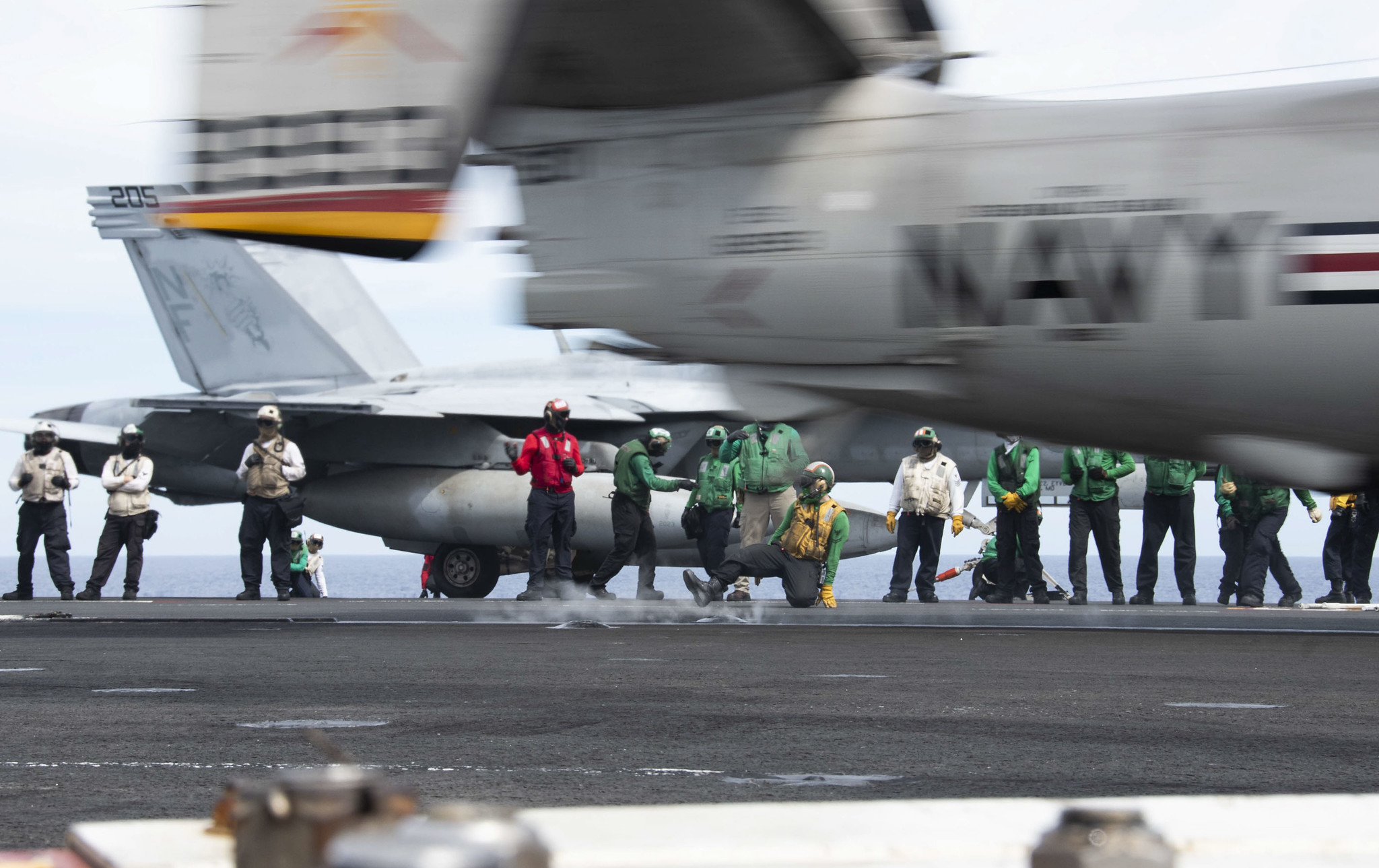 An E-2D Hawkeye launches from the flight deck of the aircraft carrier USS Ronald Reagan (CVN 76) during flight operations June 17, 2020, in the Philippine Sea. (MC3 Erica Bechard/Navy)