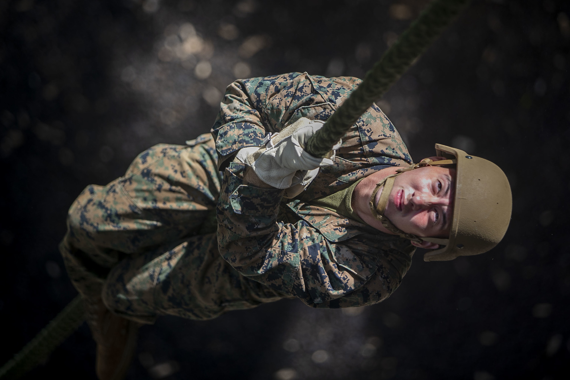 Marine Corps Lance. Cpl. Jonathen Figueroa conducts a fast roping exercise at the Lightning Academy, East Range Training Complex, Hawaii, Aug. 11, 2020. (Sgt. Luke Kuennen/Marine Corps)