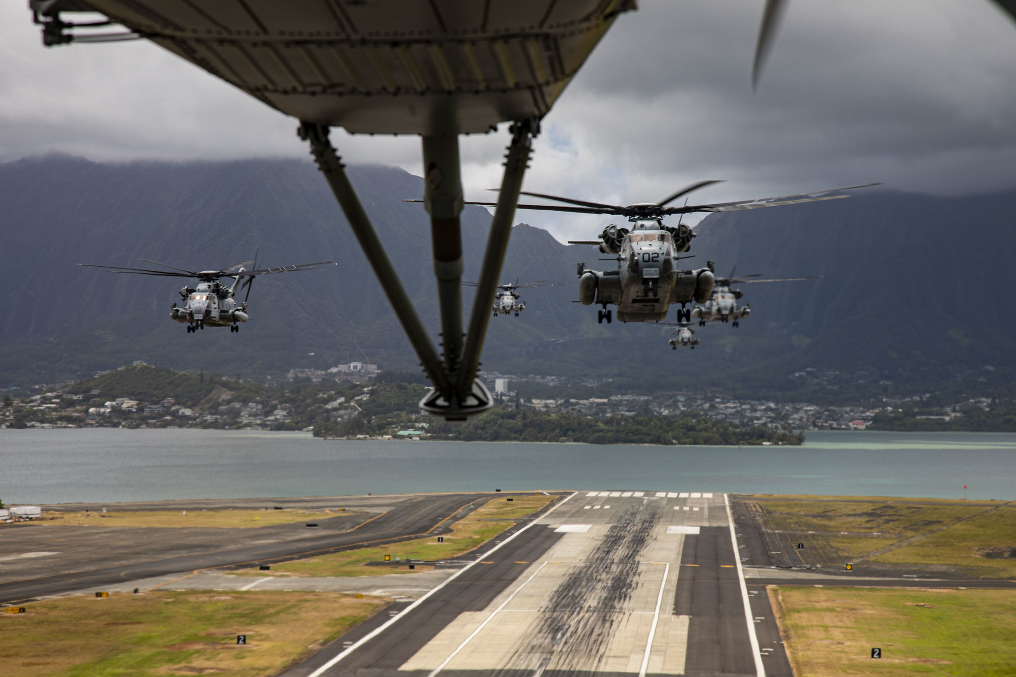 Marine Corps CH-53E Super Stallions take-off during a mass air-training mission on May 19, 2020, at Marine Corps Air Station Kaneohe Bay, Marine Corps Base Hawaii. (Lance Cpl. Samantha Sanchez/Marine Corps)