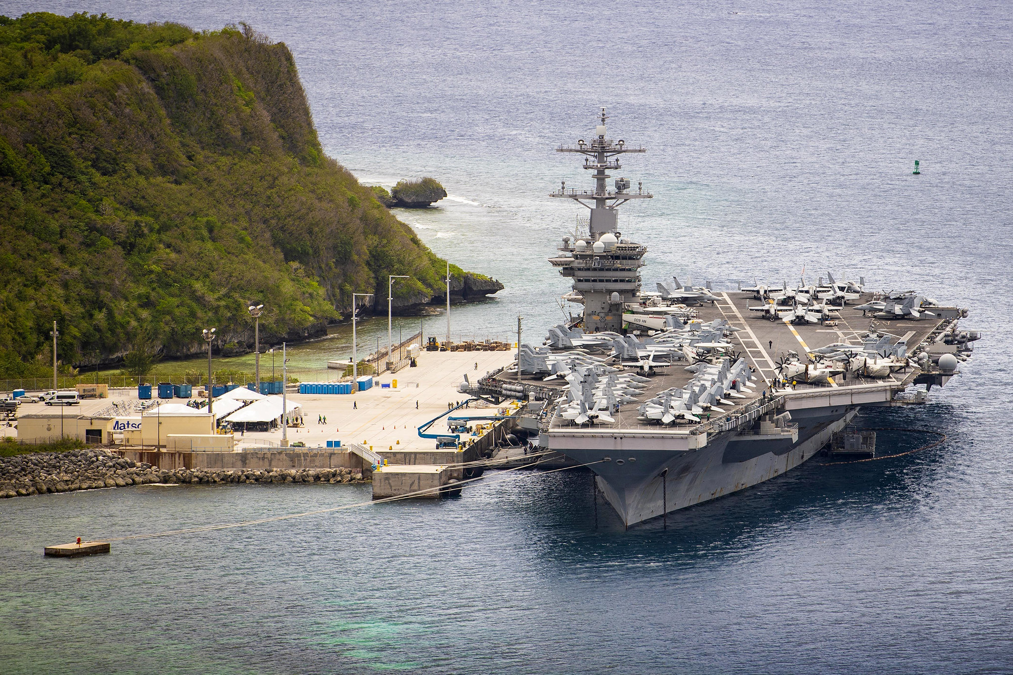 The aircraft carrier USS Theodore Roosevelt (CVN 71) is moored pier side at Naval Base Guam on May 15, 2020. (MC3 Conner D. Blake/Navy)