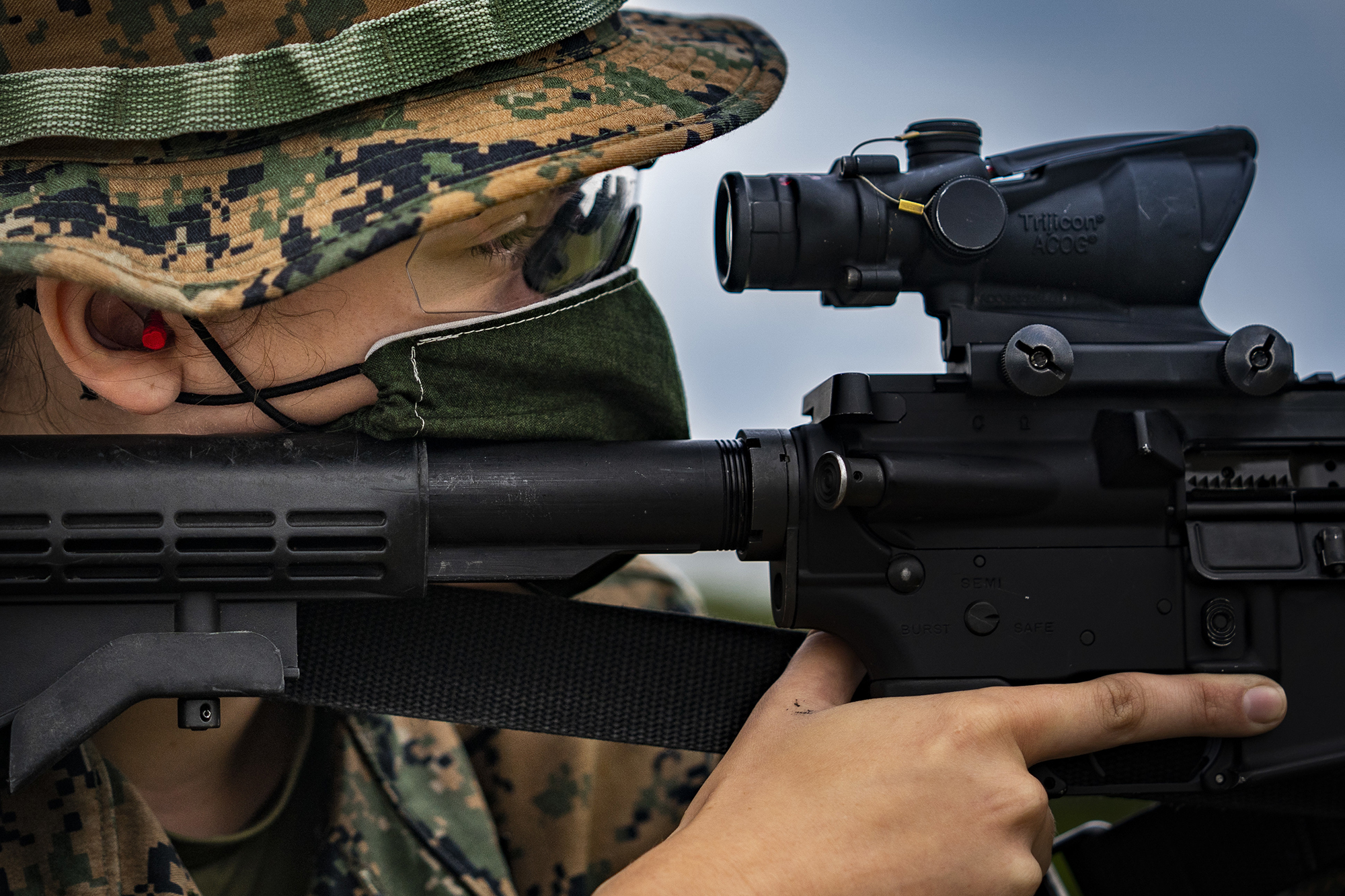 Marine Corps Lance Cpl. Faith Rose sights in on her target on Camp Hansen, Okinawa, Japan, May 6, 2020. Despite the outbreak of COVID-19, rifle ranges are still operating and enabling Marines to complete their yearly qualifications. (Cpl. Kameron Herndon/Marine Corps)