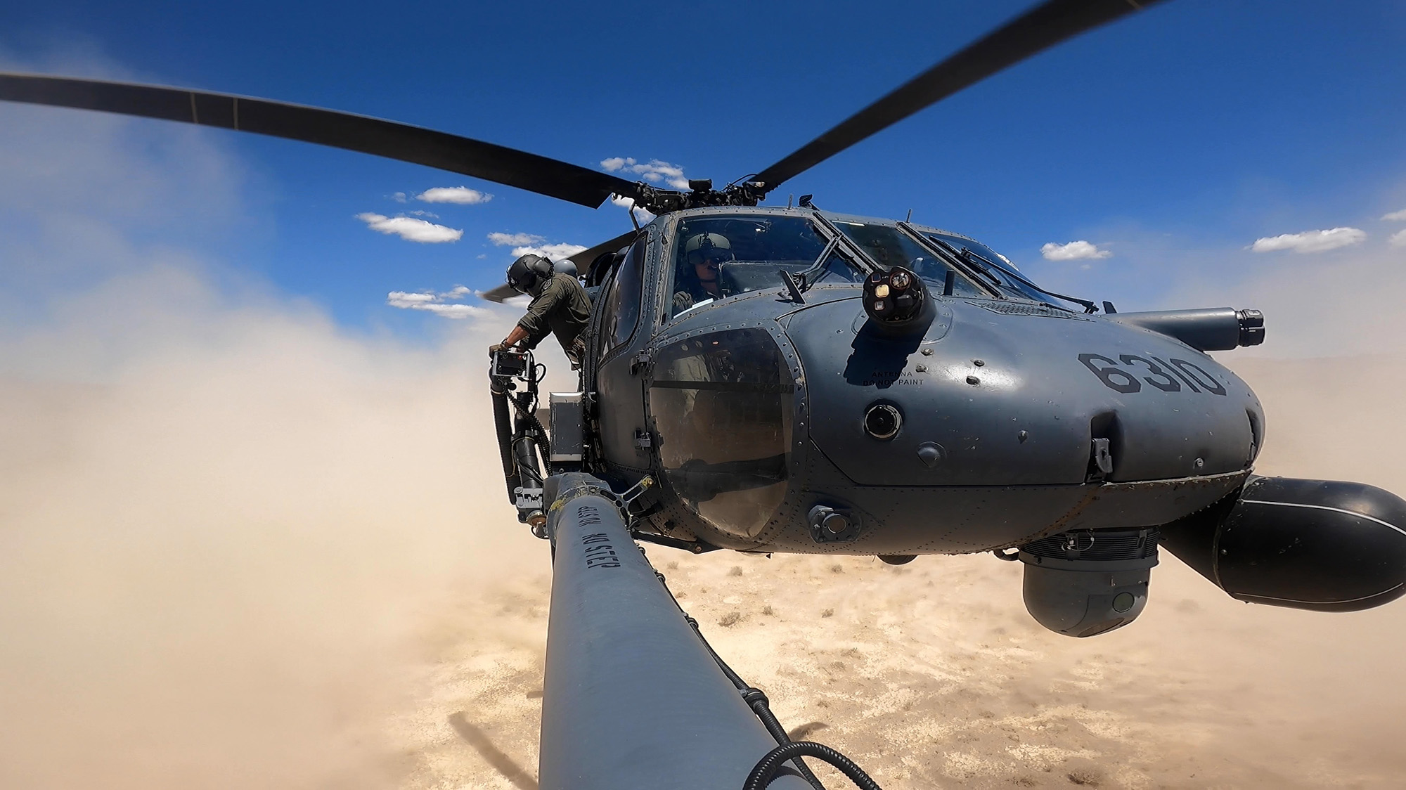 An HH-60G Pave Hawk lands during a training competition at the Nevada Test and Training Range, Nev., in this May 18, 2021, screen capture from video. (Airman 1st Class Zachary Rufus/Air Force)