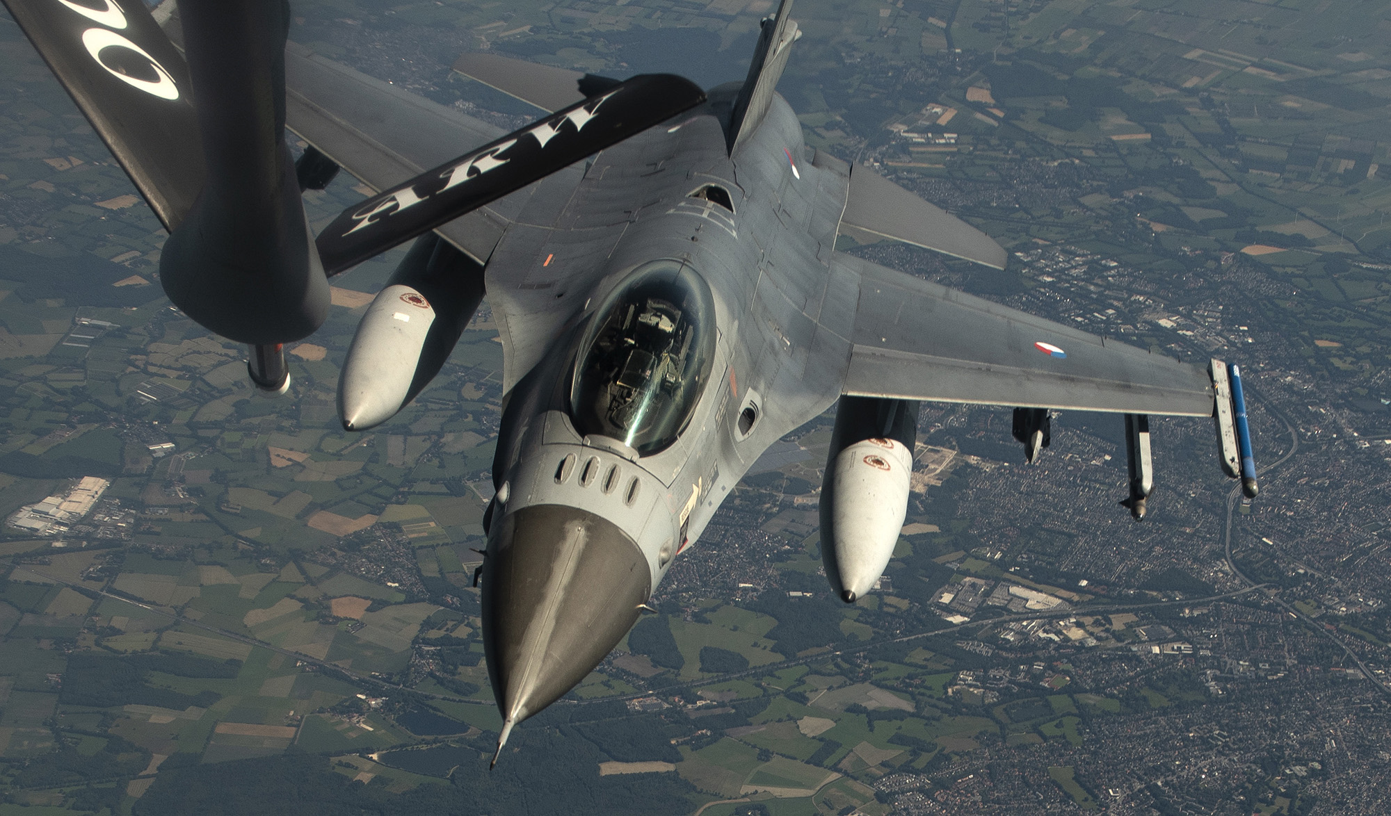 A Royal Netherlands air force F-16 Fighting Falcon approaches a U.S. Air Force KC-135 Stratotanker for refueling during a NATO Multinational Air Group exercise over Germany, June 25, 2020. (Airman 1st Class Jessi Monte/Air Force)
