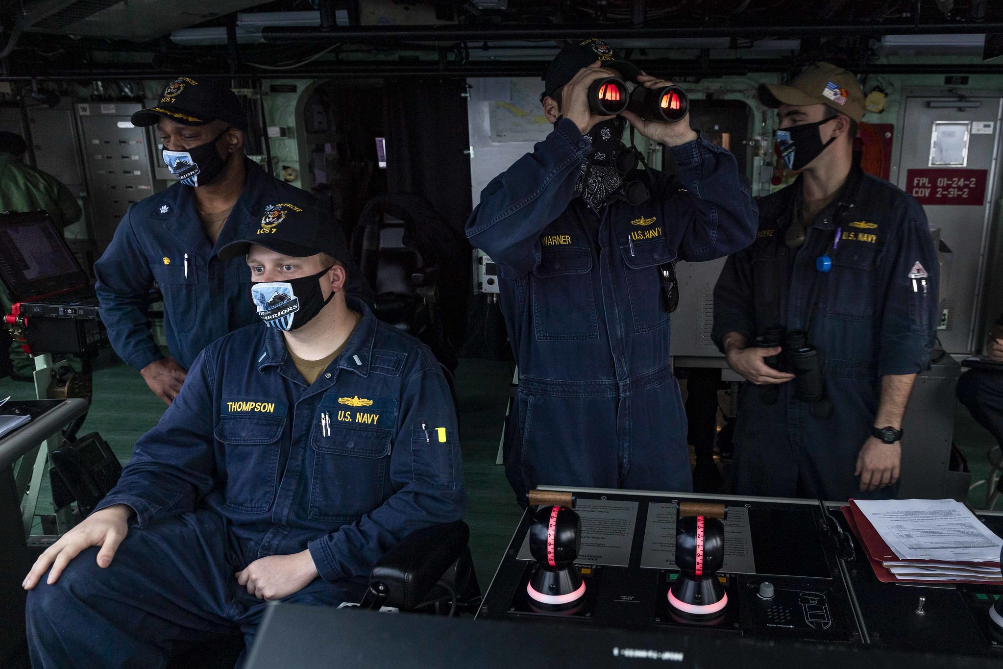 Sailors stand watch on the navigation bridge aboard the Freedom-variant littoral combat ship USS Detroit (LCS 7) as the ship pulls into Colon, Panama, on May 19, 2020, for stores and fuel. Detroit is deployed to the U.S. Southern Command area of responsibility to support Joint Interagency Task Force South's mission, which includes counter illicit drug trafficking in the Caribbean and eastern Pacific. (MC2 Anderson W. Branch/Navy)