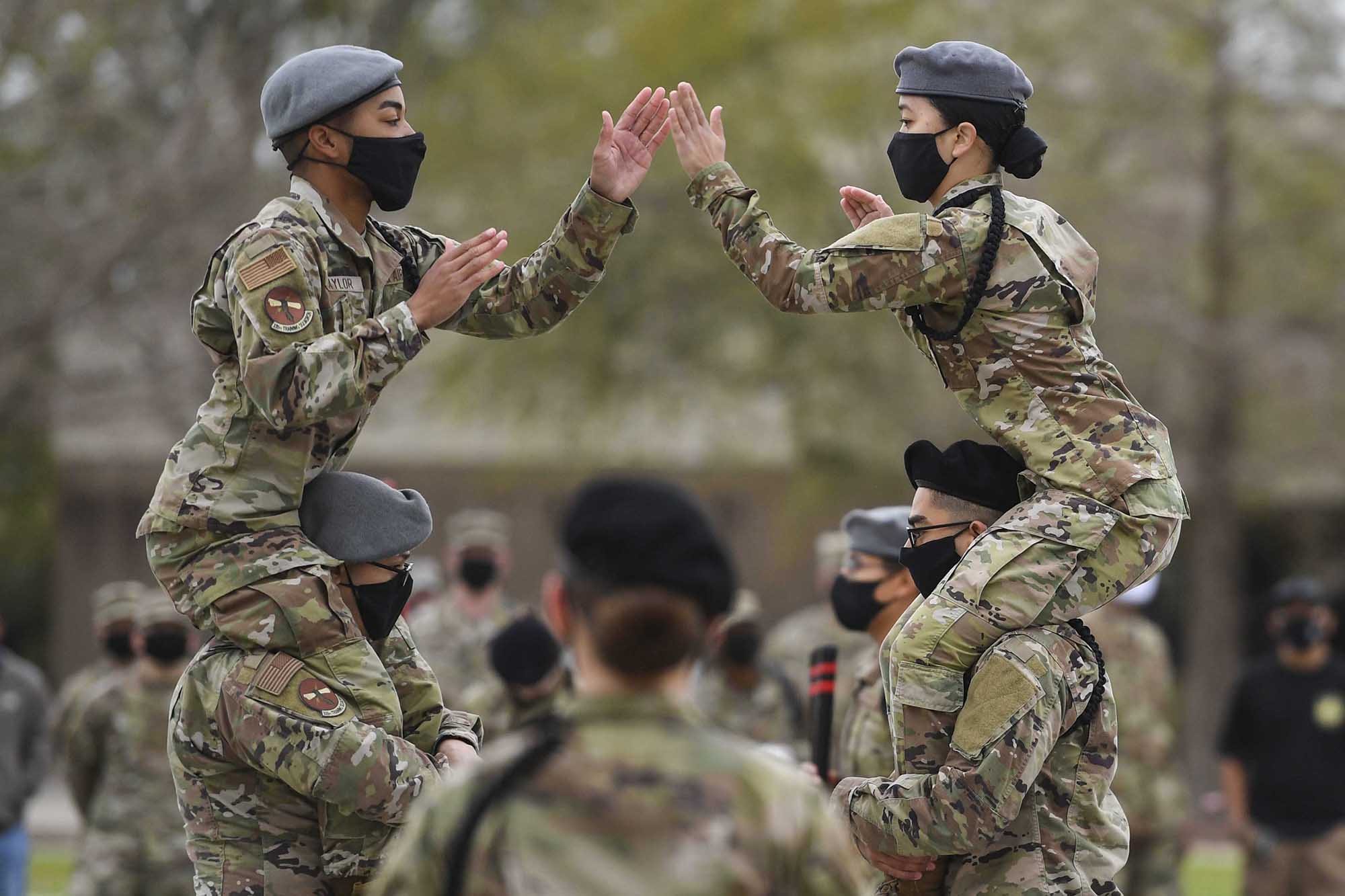 Airman 1st Class Tyrone Taylor and Airman Destiny Millerd, 335th Training Squadron freestyle drill team members, perform during the 81st Training Group drill down at Keesler Air Force Base, Miss., March 19, 2021. (Kemberly Groue/Air Force)