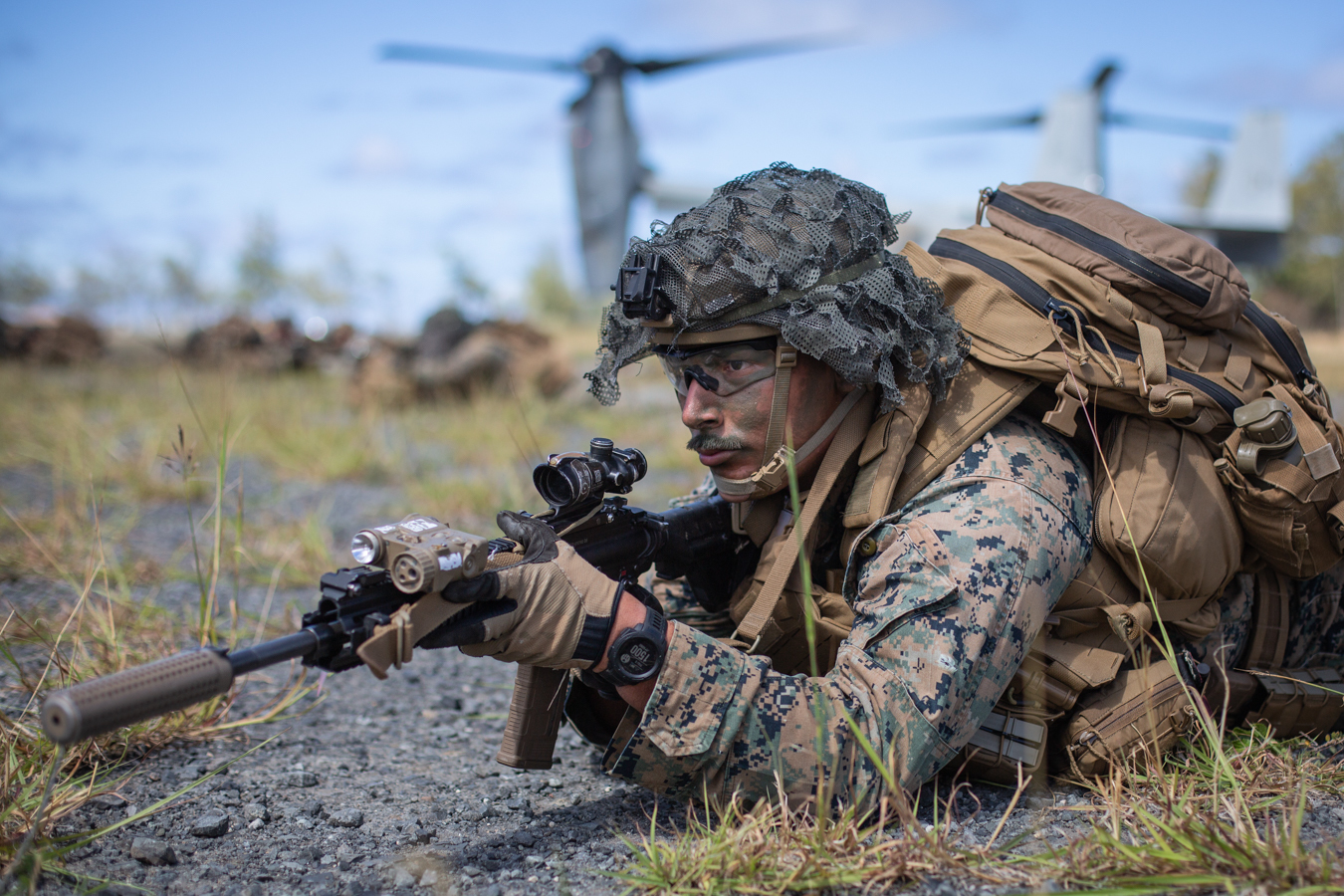 U.S. Marine Corps Cpl. Kevin Hernandez, a rifleman with 1st Battalion, 3d Marines, 3d Marine Division, provides security during an air assault at Marine Corps Training Area Bellows, Hawaii, July 9. (Cpl. Alexis Moradian/Marine Corps)
