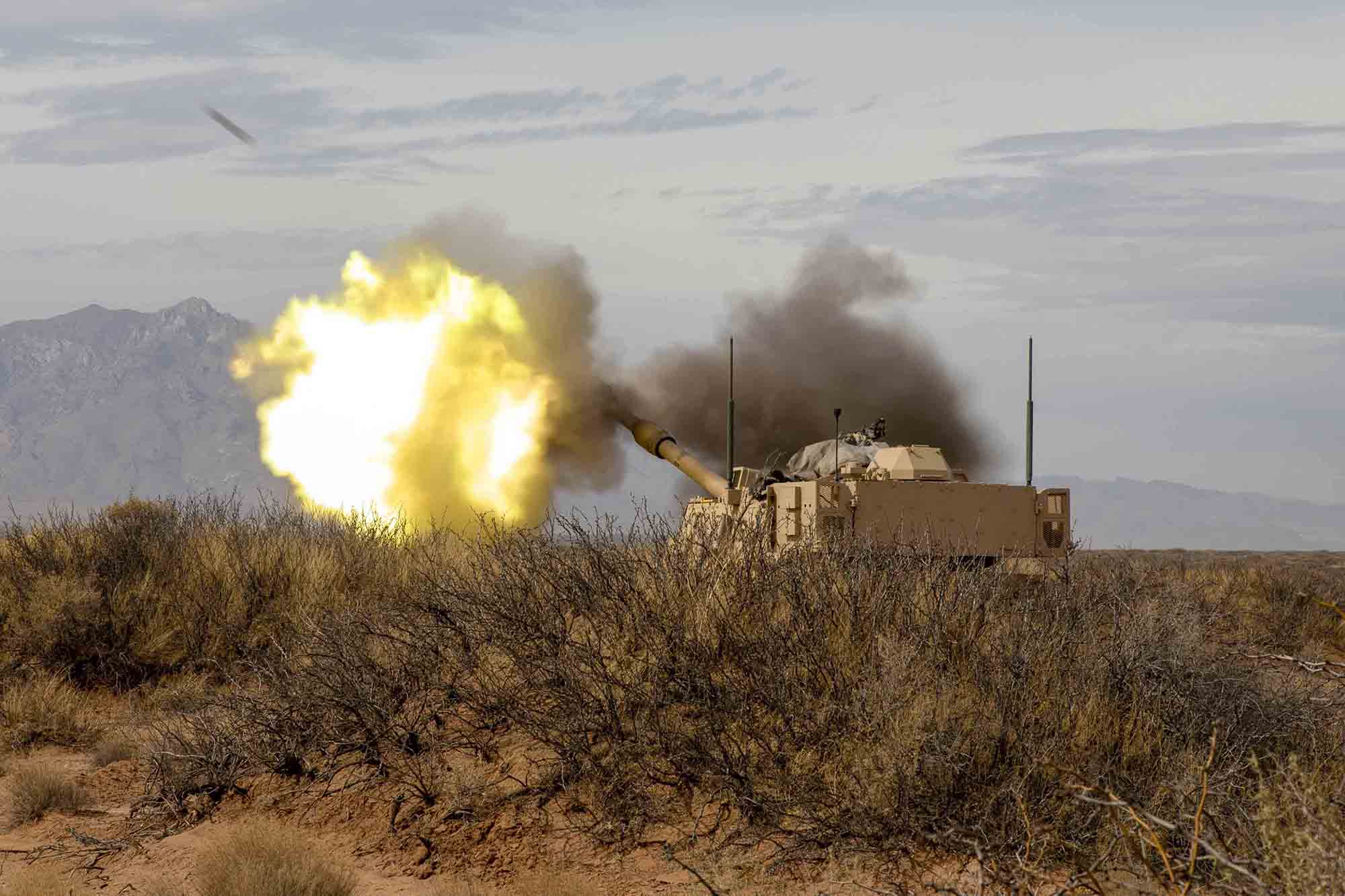 Soldiers with 2nd Battalion, 3rd Field Artillery Regiment, 1st Armored Brigade Combat Team, 1st Armored Division, shoot a M109 Paladin as part of a battalion-level artillery qualification exercise, March 8, 2021, at the Dona Ana Range Complex, N.M. (Pfc. Luis Santiago/Army)
