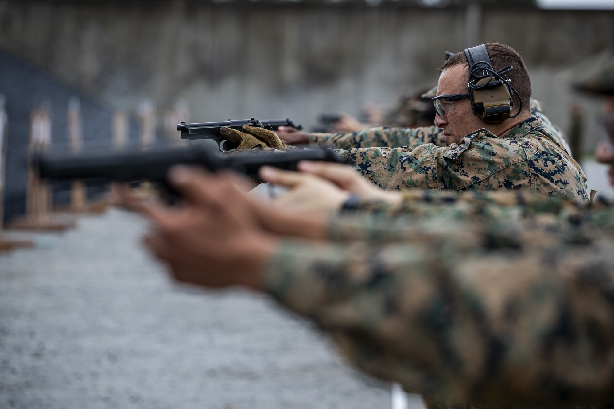 Gunnery Sgt. Nathaniel Schoenhoefer takes aim during the 2020 Far East Intramural Matches on Camp Hansen, Okinawa, Japan, Dec. 10, 2020. (Lance Cpl. Zachary Larsen/Marine Corps)