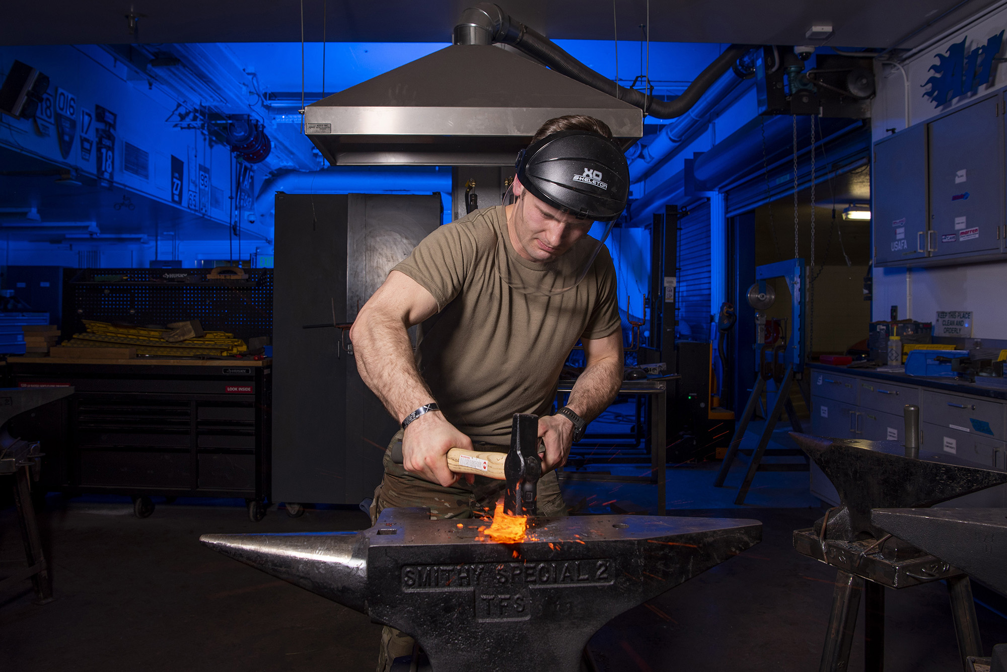 Cadet 1st Class Isaac Perkins shapes a piece of hot steel into a knife as part of the physical metallurgy class in the Air Force Academy's mechanical engineering metal fabrication laboratory, Feb. 17, 2021. (Joshua Armstrong/Air Force)