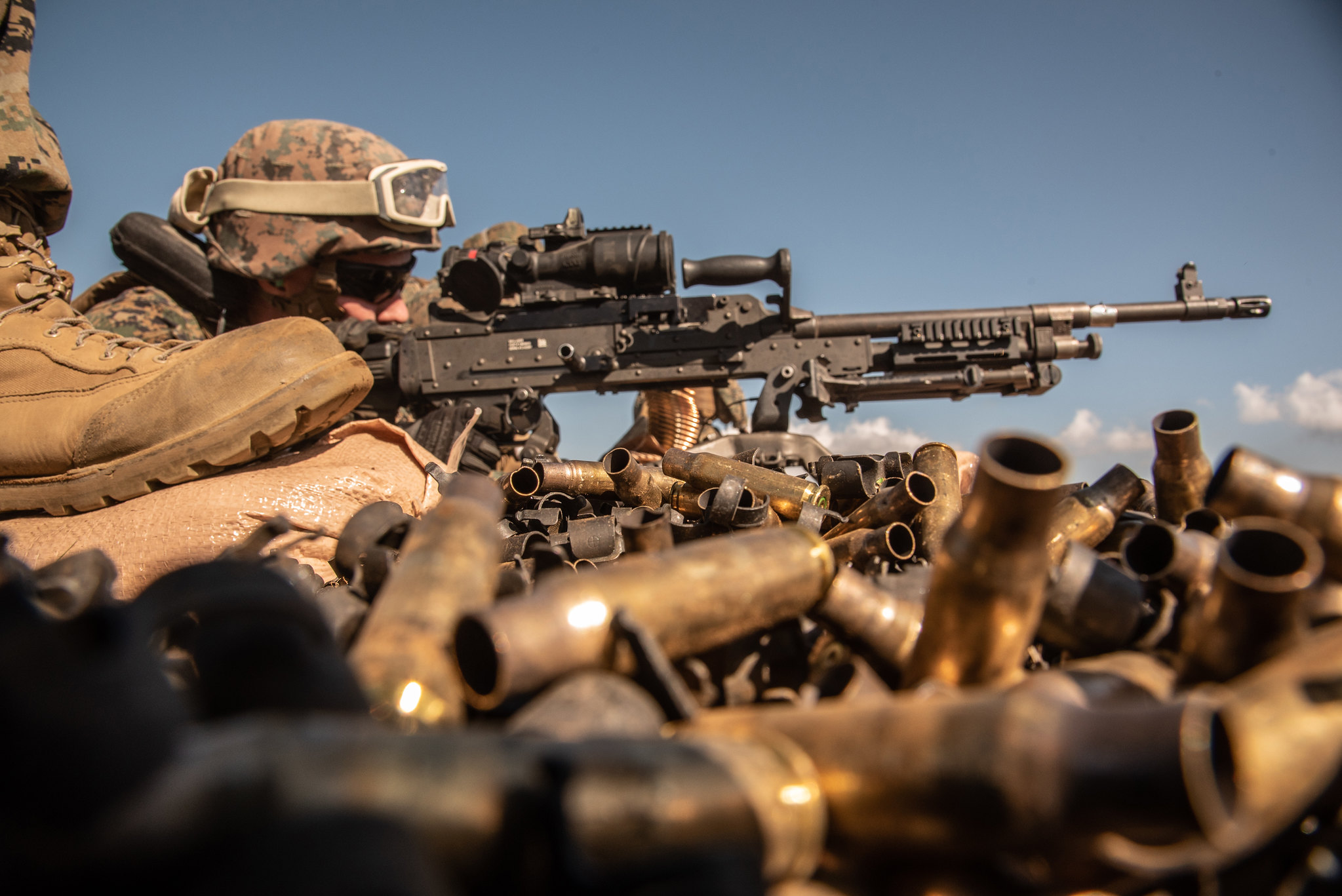 Hospital Corpsman 2nd Class Christopher Walters fires an M240B machine gun during Artillery Relocation Training Program 21.1 at the Combined Arms Training Center at Camp Fuji, Japan, April 26, 2021. (Cpl. Michael Jefferson Estillomo/Marine Corps)