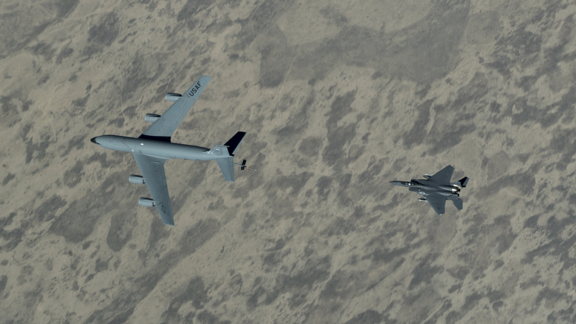 A U.S. Air Force F-15E Strike Eagle approaches a KC-135 Stratotanker over the U.S. Central Command area of responsibility on June 12, 2020. (Senior Airman Brandon Cribelar/Air Force)