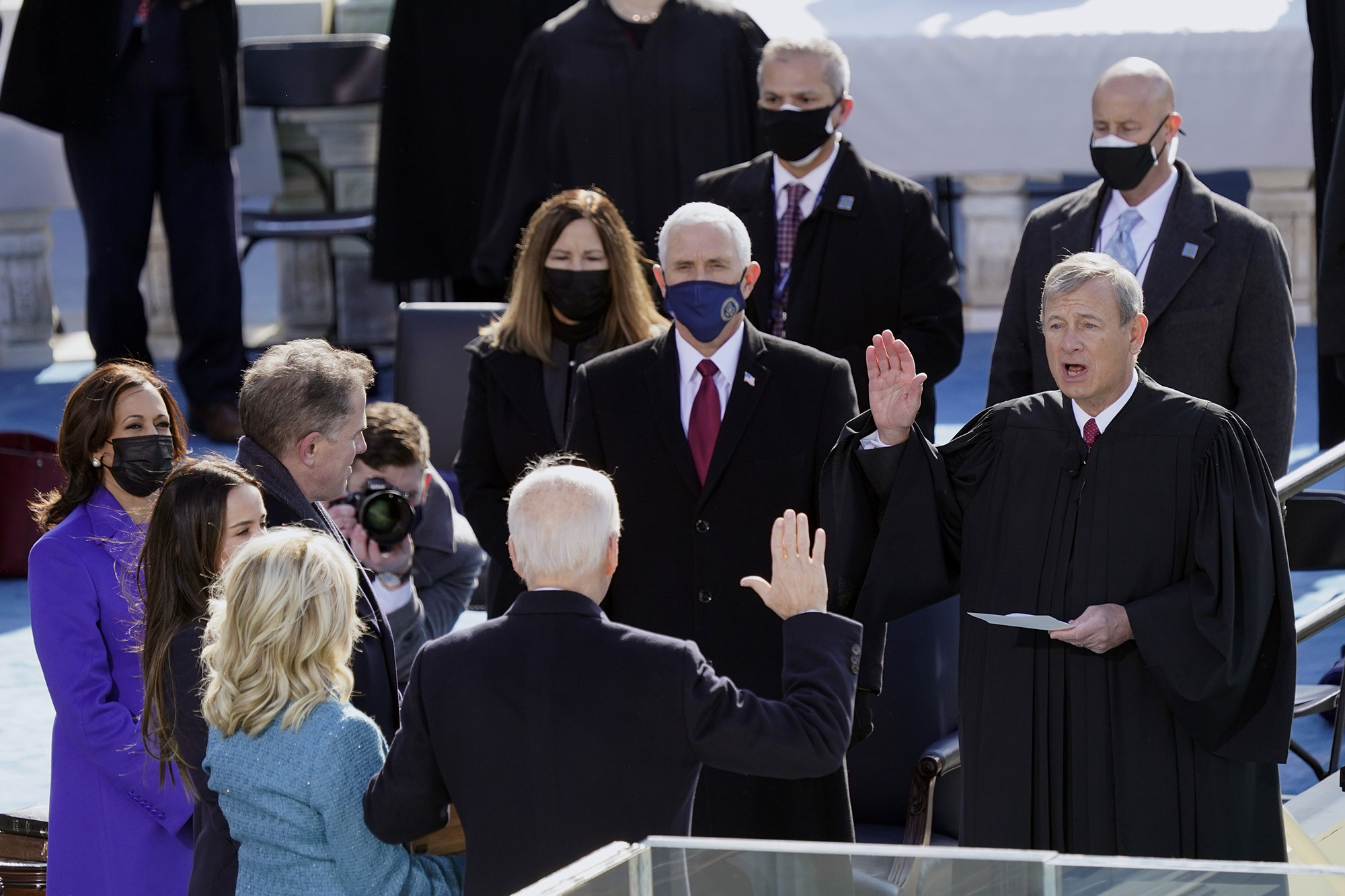 Joe Biden is sworn in as the 46th President of the United States by Chief Justice John Roberts, while Jill Biden holds the Bible during the 59th Inauguration of the President at the U.S. Capitol in Washington on Wednesday, January 20, 2021. (Carolyn Kaster / AP)