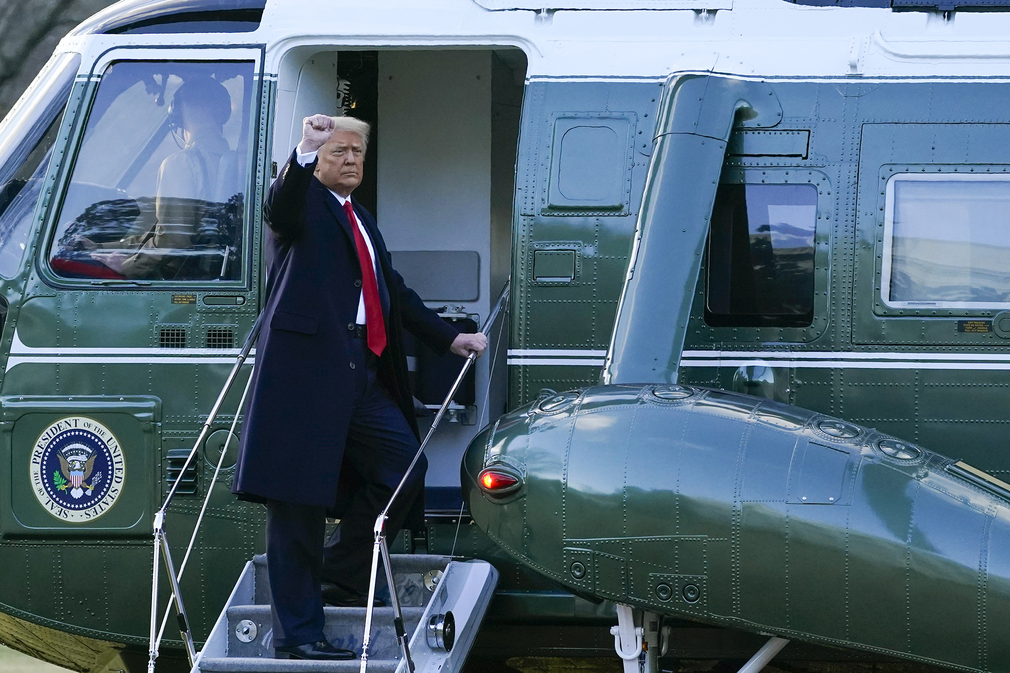 President Donald Trump gestures as he boards Marine One on the South Lawn of the White House, Wednesday, Jan. 20, 2021, in Washington. Trump is en route to his Mar-a-Lago Florida Resort. (Alex Brandon/AP)