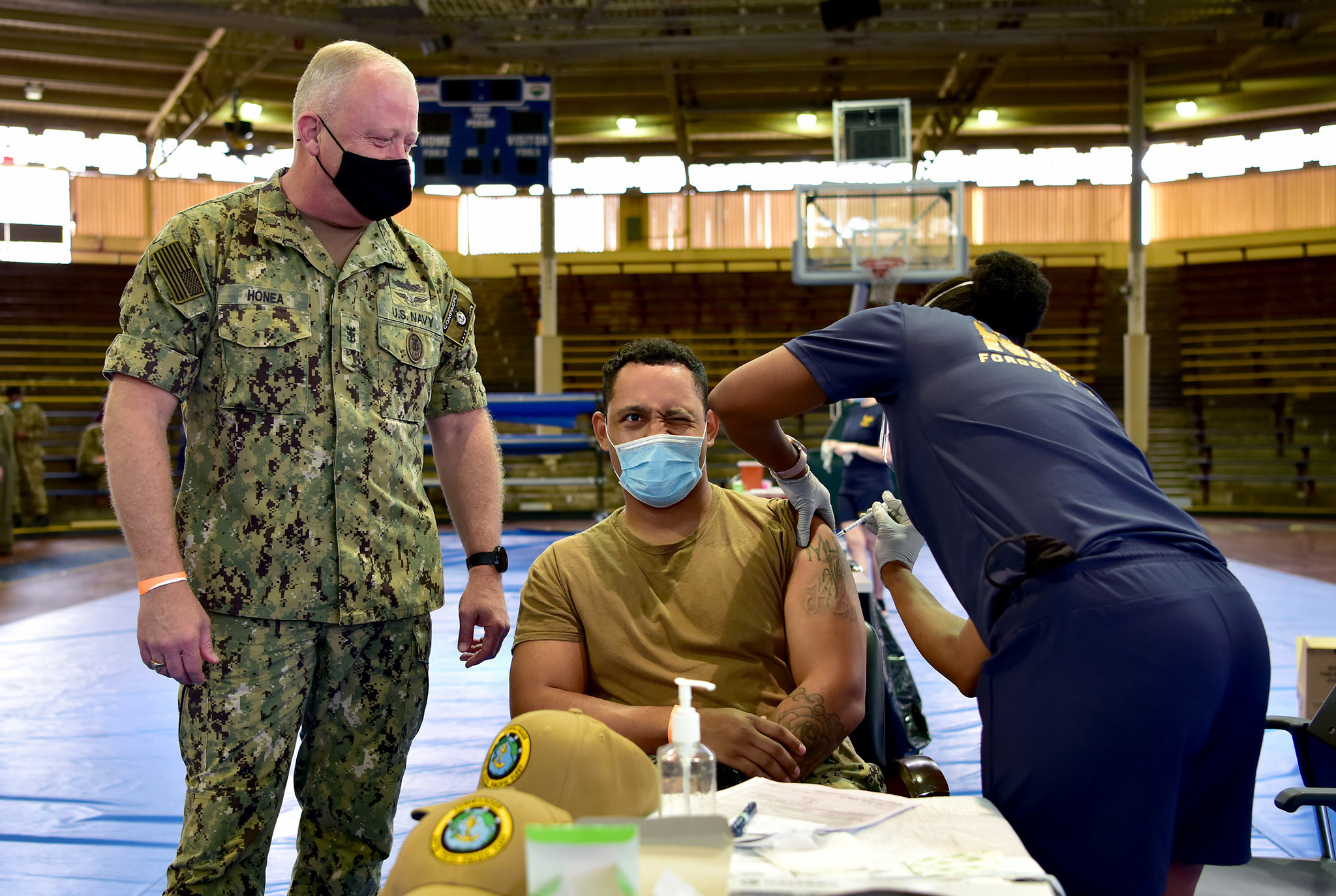 Master-at-Arms 1st Class Patrick Moore receives the COVID-19 vaccine as U.S. Pacific Fleet Fleet Master Chief James Honea observes at Joint Base Pearl Harbor-Hickam, Dec. 29, 2020. (Chief Mass Communication Specialist Jay C. Pugh/Navy)