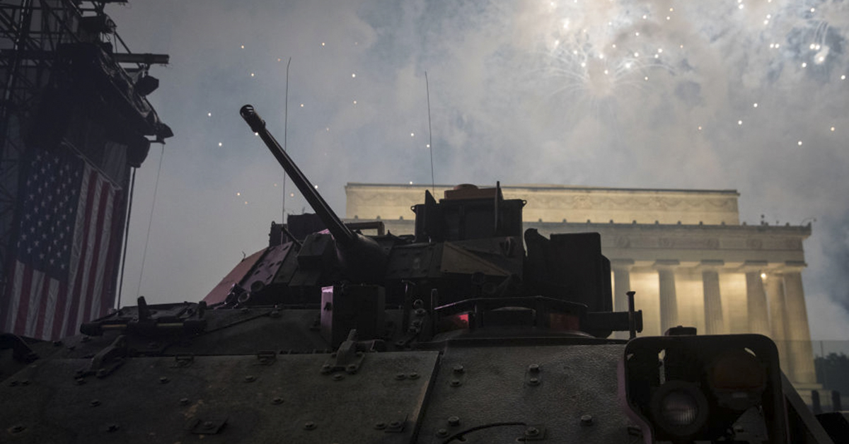 A U.S. Army Bradley Fighting Vehicle is seen during a fireworks display that followed the