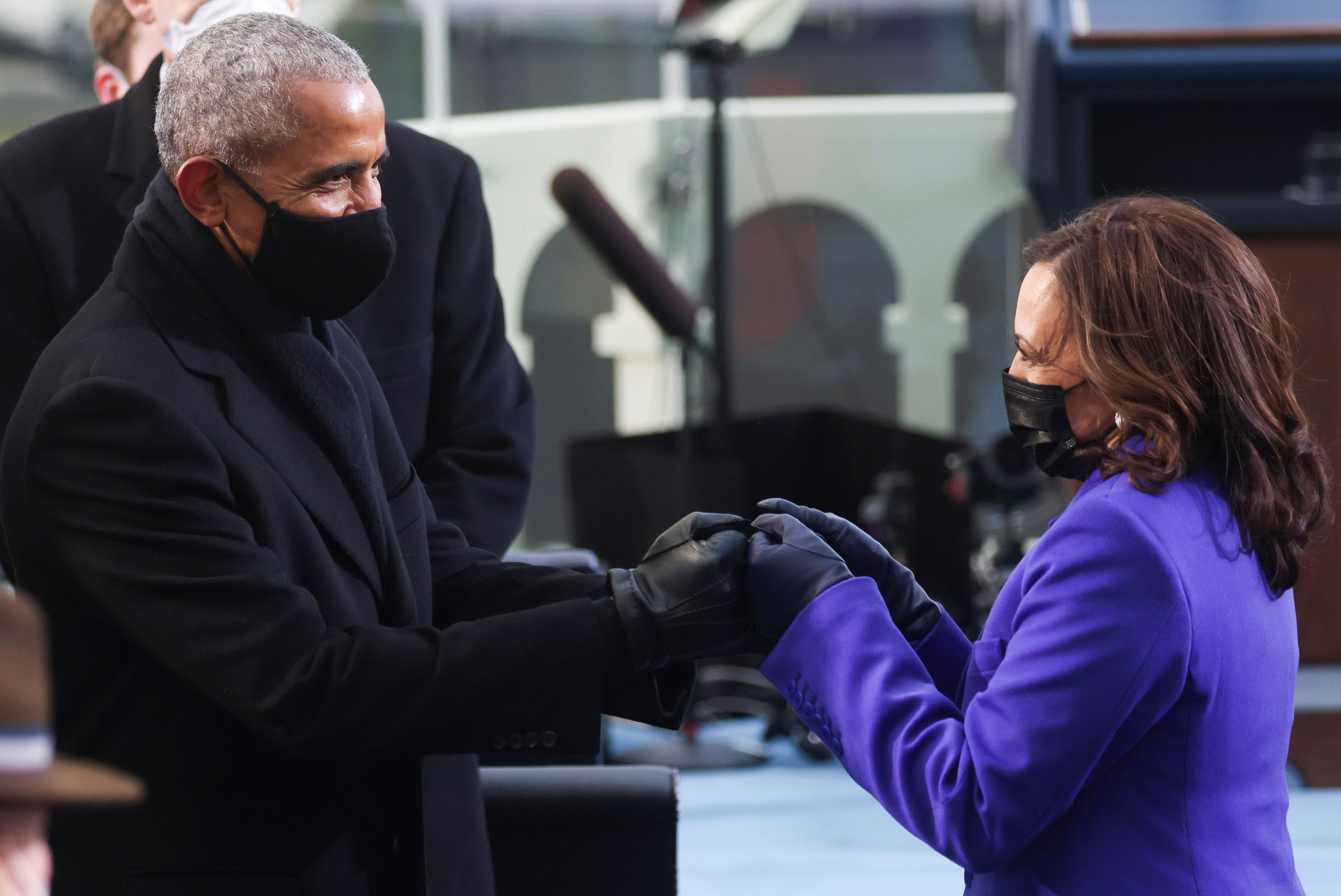 Former President Barack Obama, left, bumps fists with Vice President-elect Kamala Harris as they arrive for the inauguration of Joe Biden as the 46th president on the West Front of the Capitol in Washington on Jan. 20, 2021. (Jonathan Ernst/Pool, AFP via Getty Images)