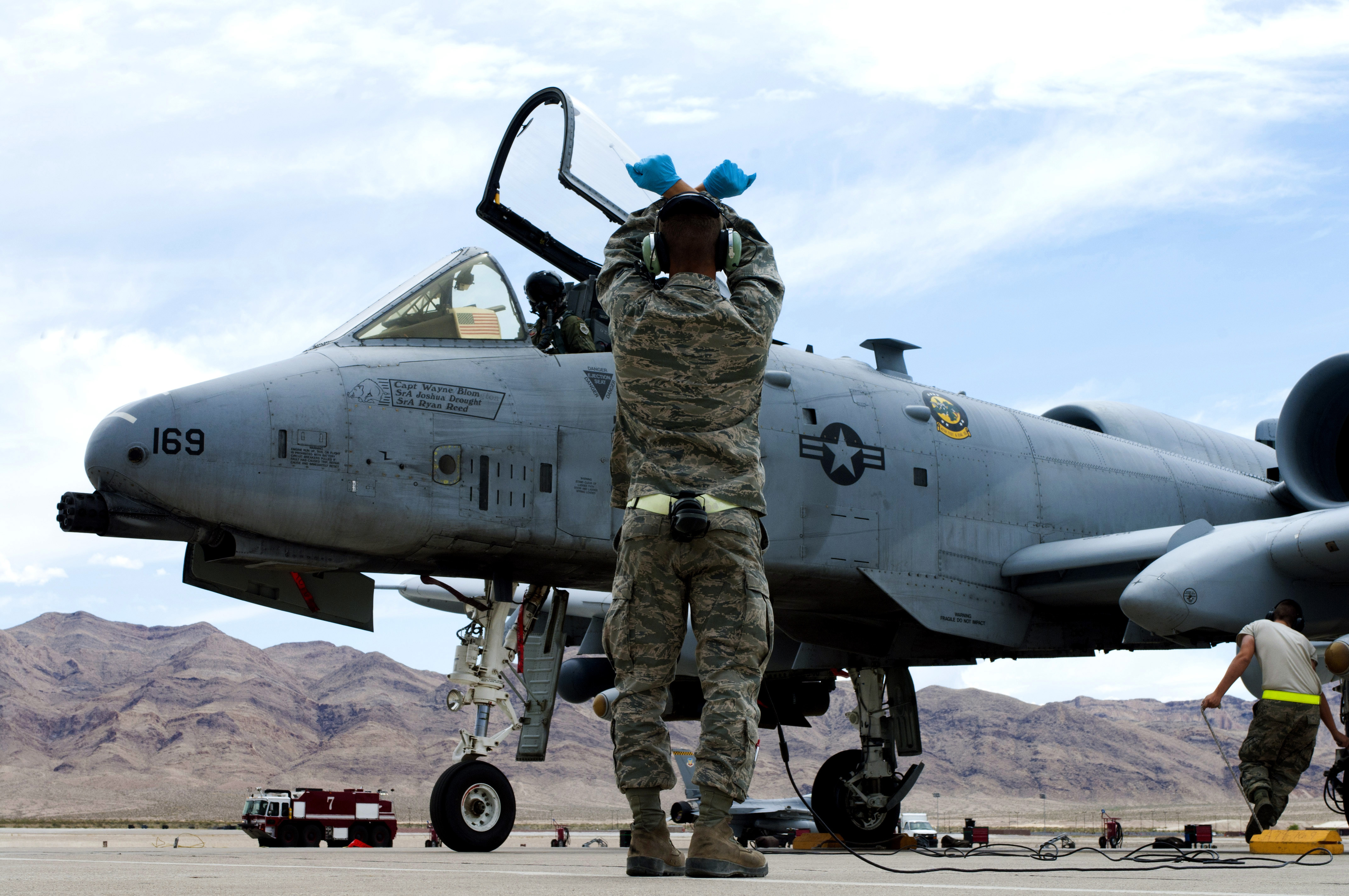 Airman Brandon Kempf, 757th Aircraft Maintenance Squadron assistant dedicated A-10 Thunderbolt II crew chief, watches as an aircraft taxis into position after landing in 2013 at Nellis Air Force Base, Nevada. (Airman 1st Class Joshua Kleinholz/U.S. Air Force)