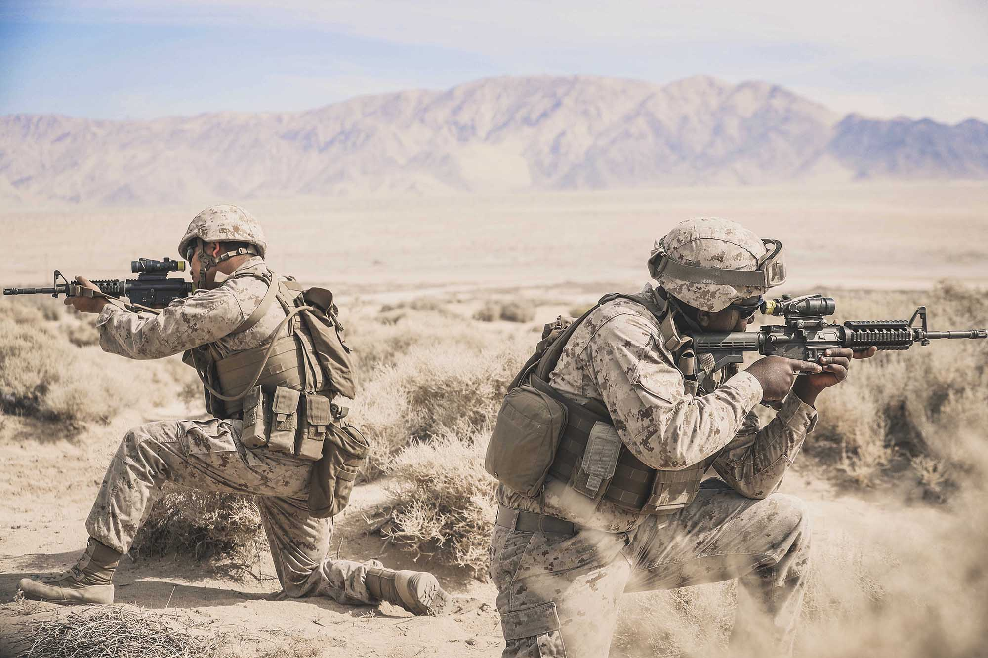 Cpl. Sathya Breckinridge and Lance Cpl. Keavious Blackmon provide cover during Integrated Training Exercise 1-21 at Marine Air Ground Combat Center Twentynine Palms, Calif., Oct. 5, 2020. (Lance Cpl. Zachary Zephir/Marine Corps)