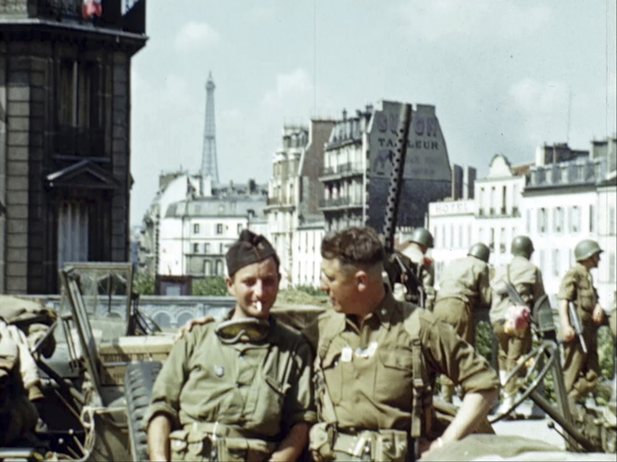 U.S. soldiers in Paris with the Eiffel Tower in the background during World War II after the liberation of Paris in August 1944. Seventy-five years later, surprising color images of the D-Day invasion and aftermath bring an immediacy to wartime memories. They were filmed by Hollywood director George Stevens and rediscovered years after his death. (War Footage From the George Stevens Collection at the Library of Congress via AP)