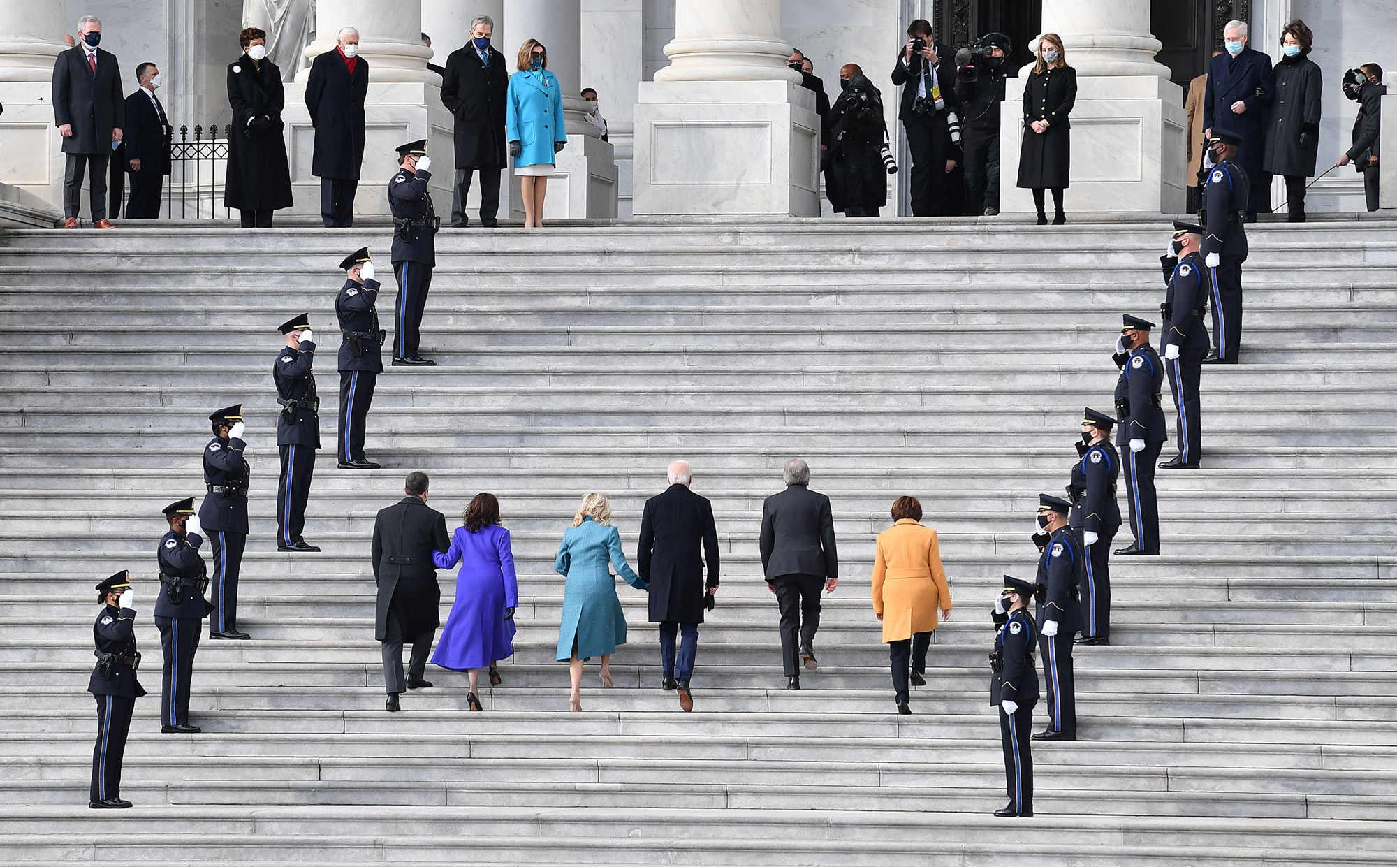Left to right: Doug Emhoff, Vice President-elect Kamala Harris, incoming first lady Jill Biden, President-elect Joe Biden, Missouri Sen. Roy Blunt and Minnesota Sen. Amy Klobuchar arrive for the inauguration of Joe Biden as the 46th president on Jan. 20, 2021, at the Capitol in Washington. (Angela Weiss/AFP via Getty Images)