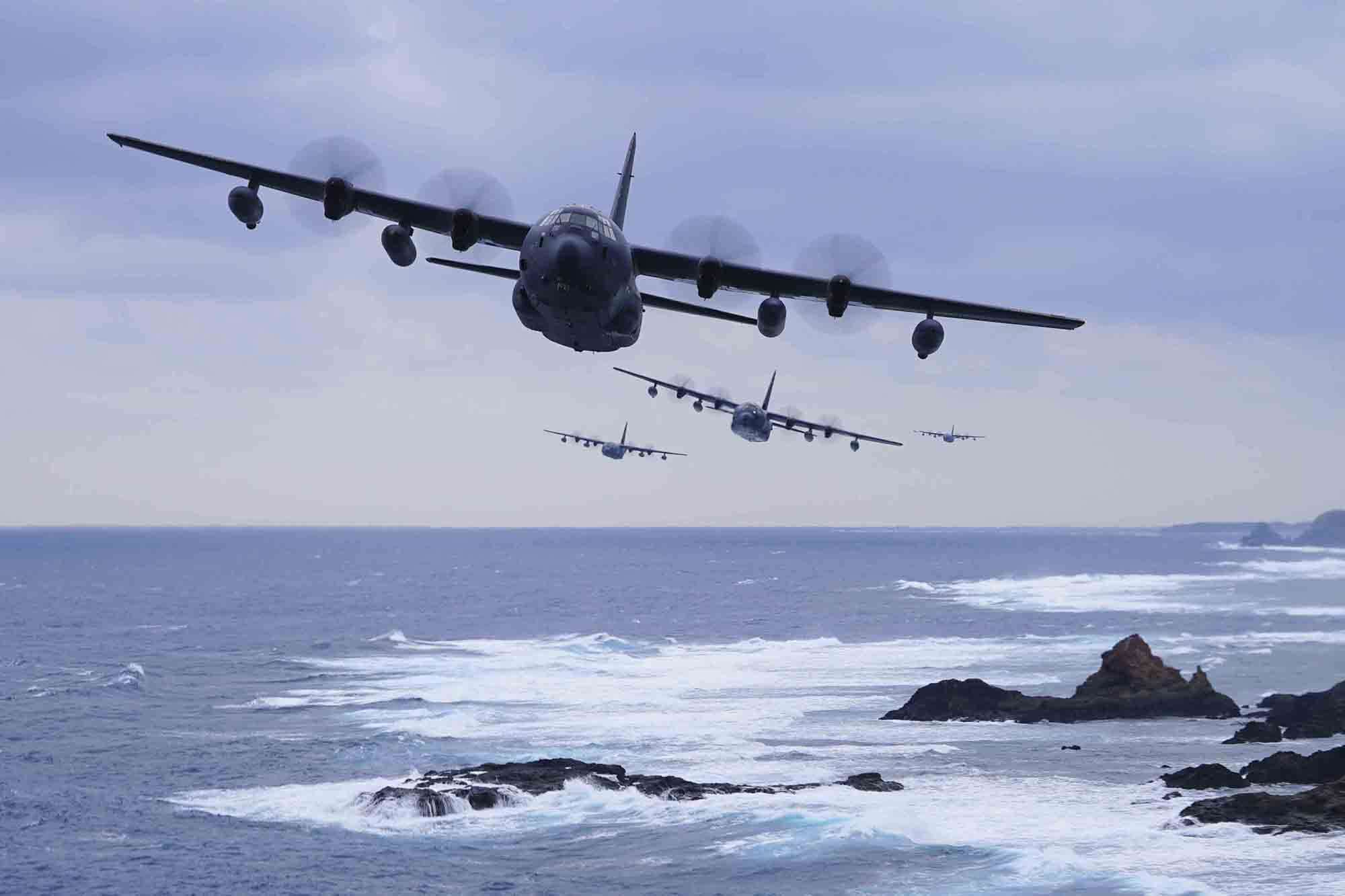 A formation of MC-130J Command IIs flies off the coast of Okinawa, Japan, on Jan. 6, 2021. (Capt. Renee Douglas/Air Force)