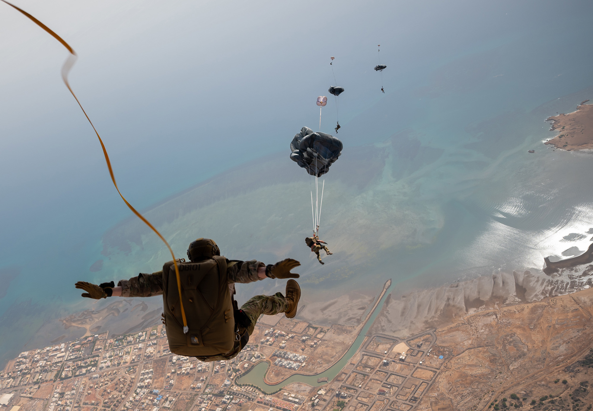 Pararescue airmen perform static line and military free-fall jumps from a Marine Aerial Refueler Transport Squadron-234 KC-130J over Djibouti, May 17, 2021. (Tech. Sgt. Daniel Asselta/Air Force)