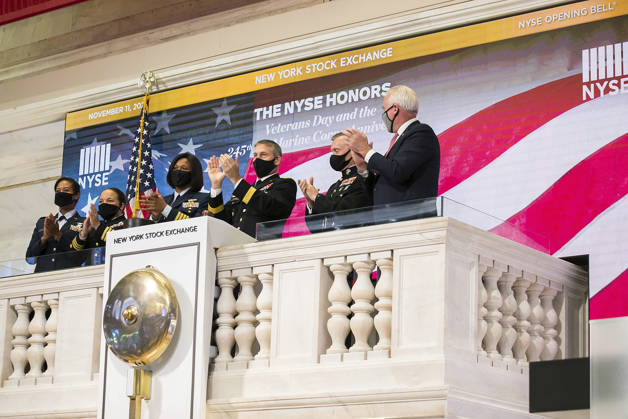 Members of the U.S. Coast Guard, Air Force, Navy and Army ring the opening bell at the New York Stock Exchange on Veterans Day, Wednesday, Nov. 11, 2020, in New York. (Courtney Crow/New York Stock Exchange via AP)