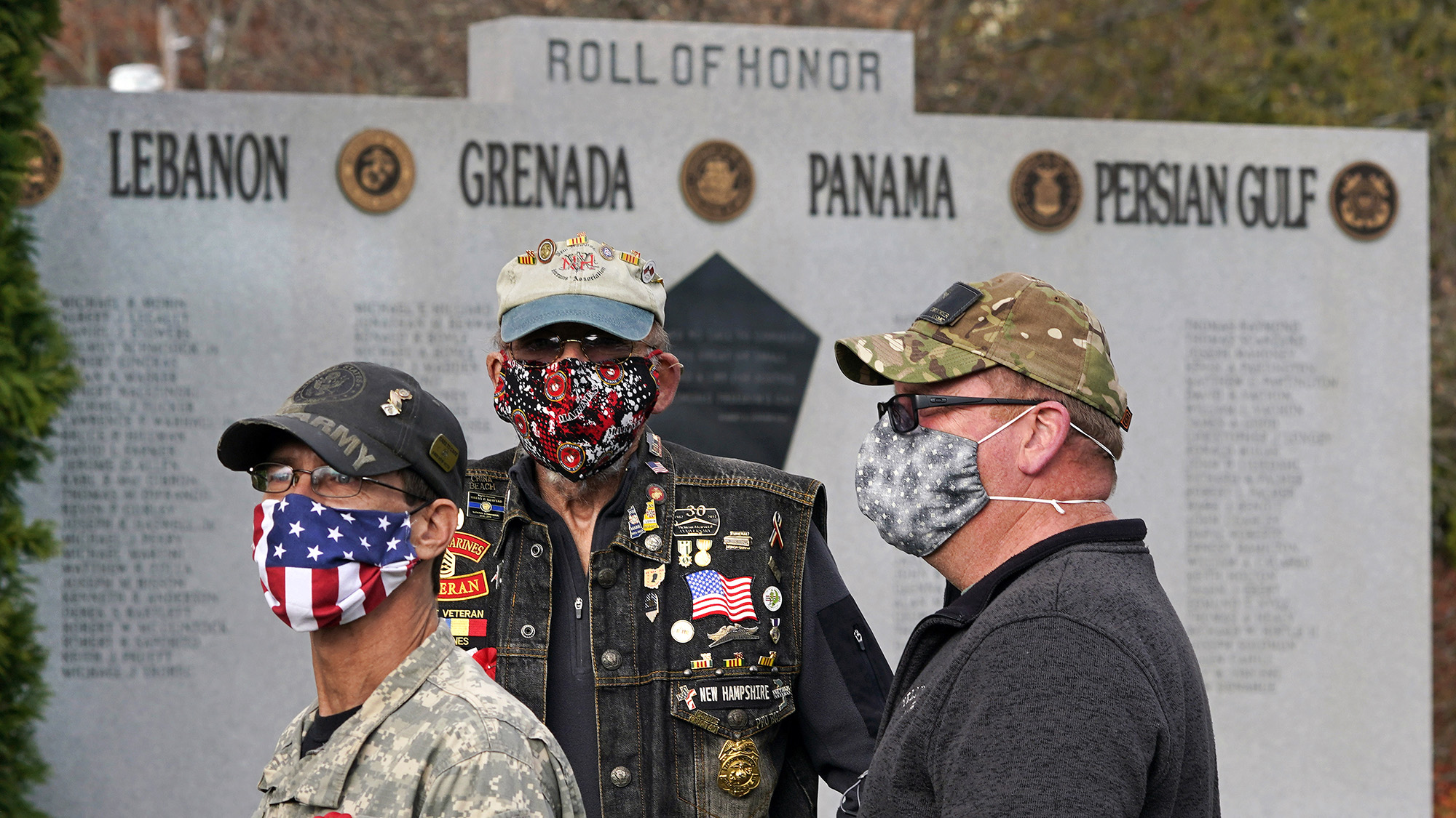 Veterans, wearing protective masks due to the COVID-19 virus outbreak, gather during a Veterans Day ceremony, Wednesday, Nov. 11, 2020, in Derry, N.H. (Charles Krupa/AP)