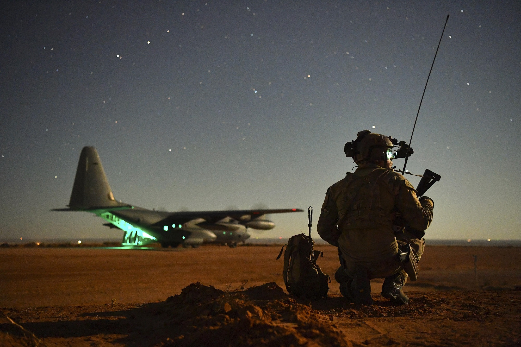 A Special Tactics operator guides a 27th Special Operations Wing MC-130J onto a runway during an exercise Nov. 6, 2020, at Melrose Air Force Range, N.M. (Staff Sgt. Ridge Shan/Air Force)